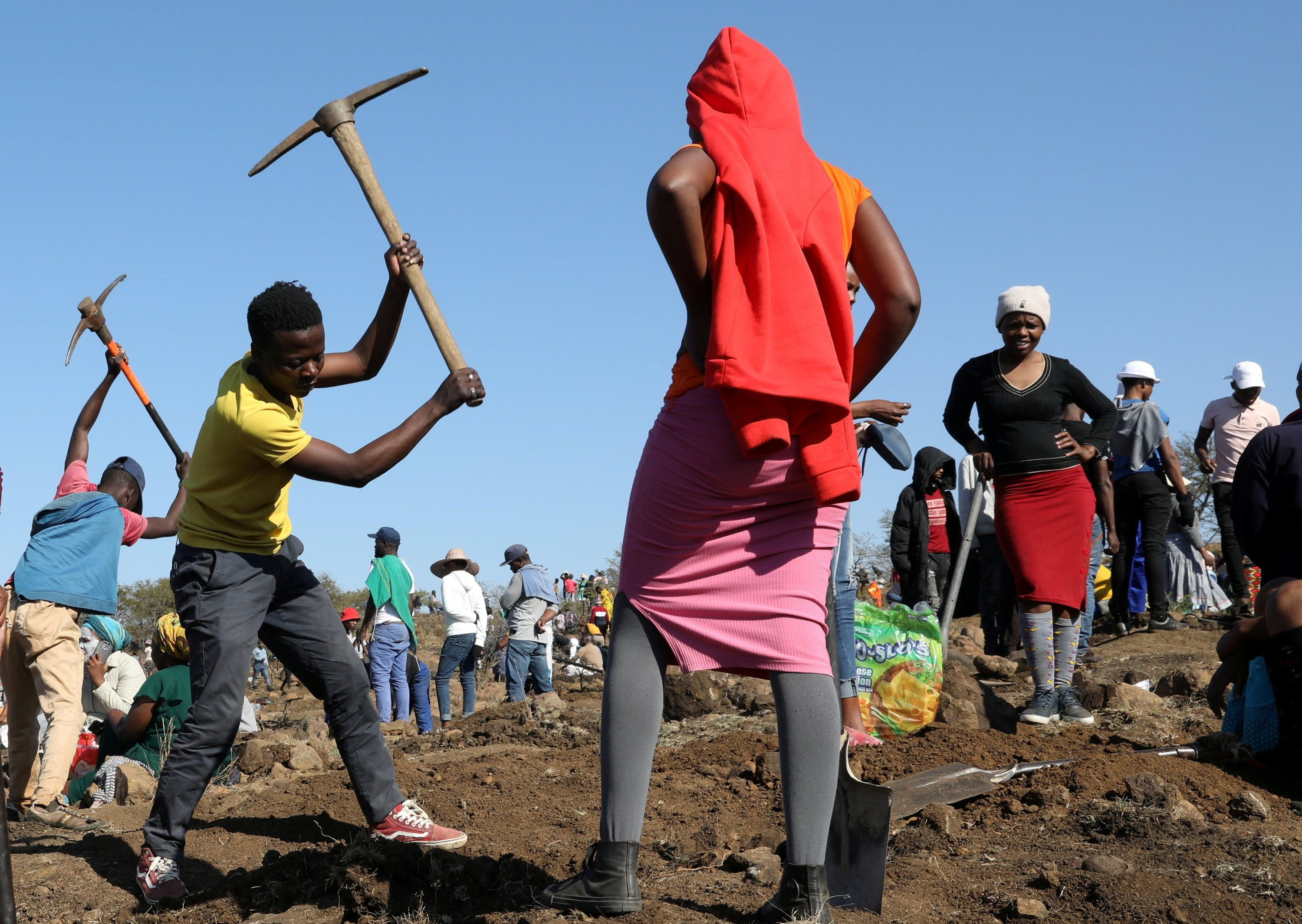 A person uses a pickaxe to dig as fortune seekers flock to KwaHlathi village near Ladysmith in KwaZulu Natal, South Africa, June 14, 2021. (Reuters Photo)