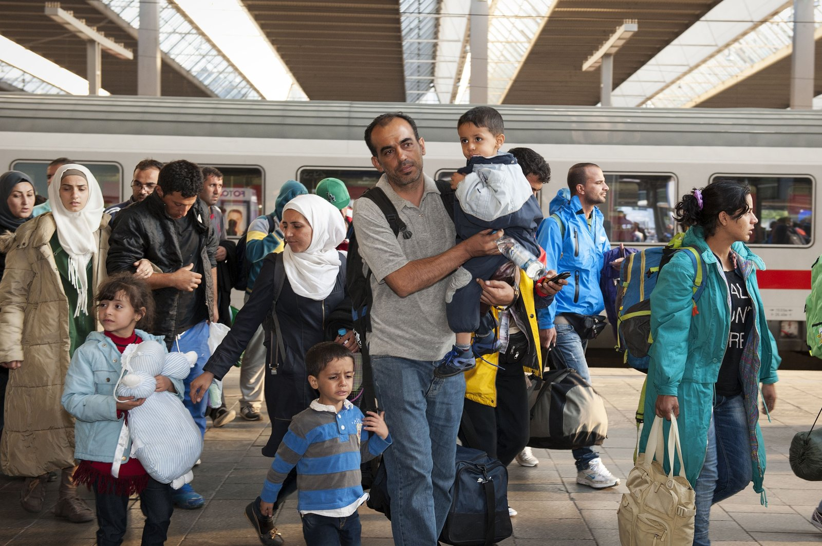 Refugees from Syria, Afghanistan and Balkan countries hopping on the next train at the main station in Munich, Germany, Sept. 10, 2015. (Shutterstock Photo)
