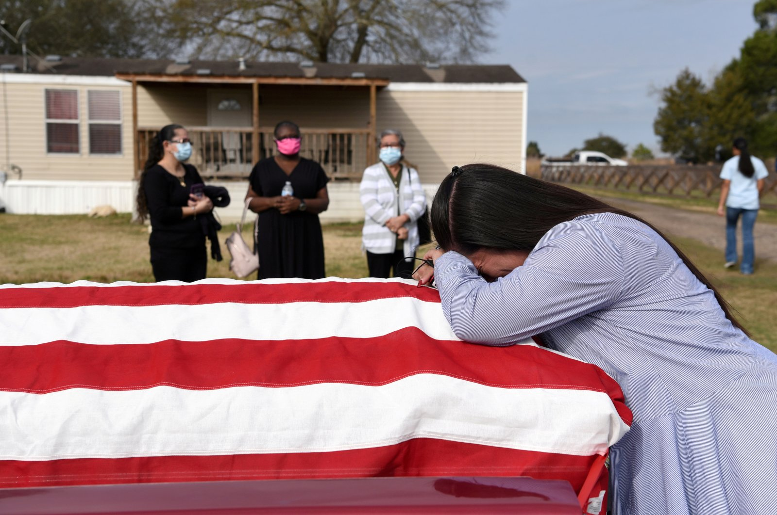 Lila Blanks holds the casket of her husband, Gregory Blanks, 50, who died of the coronavirus, ahead of his funeral in San Felipe, Texas, U.S., Jan. 26, 2021. (Reuters Photo)