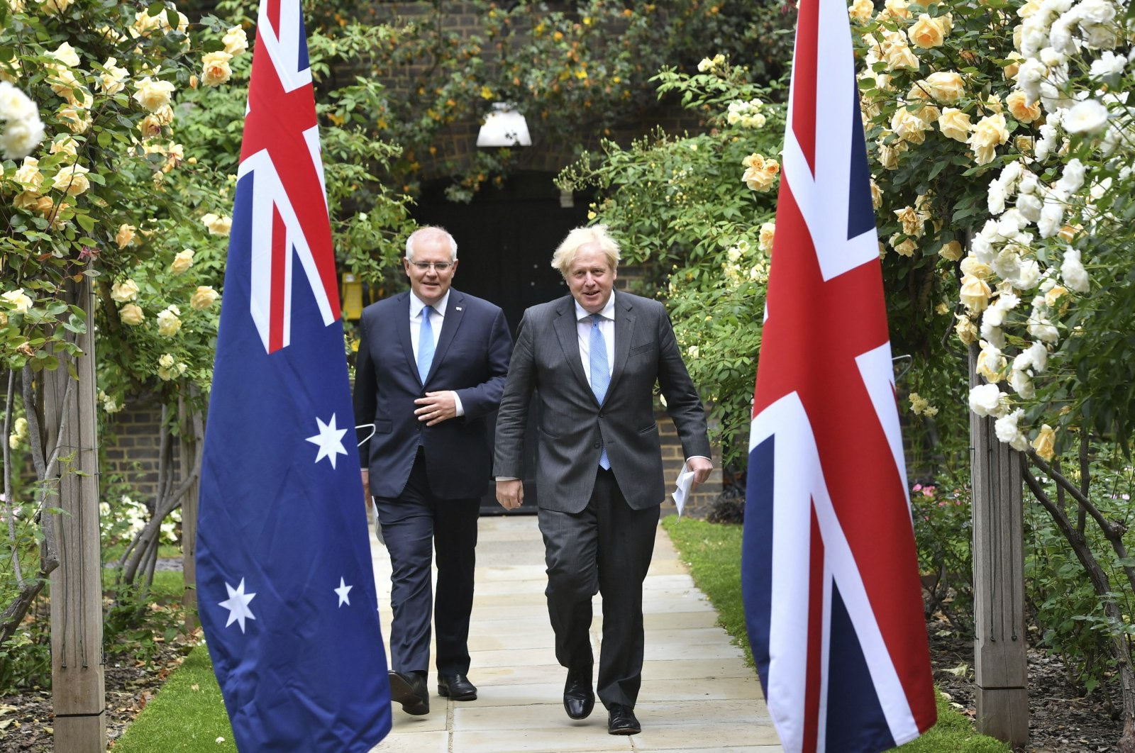 Britain's Prime Minister Boris Johnson (R) walks with Australian Prime Minister Scott Morrison after their meeting, in the garden of 10 Downing Street, London, the U.K., June 15, 2021. (AP Photo)