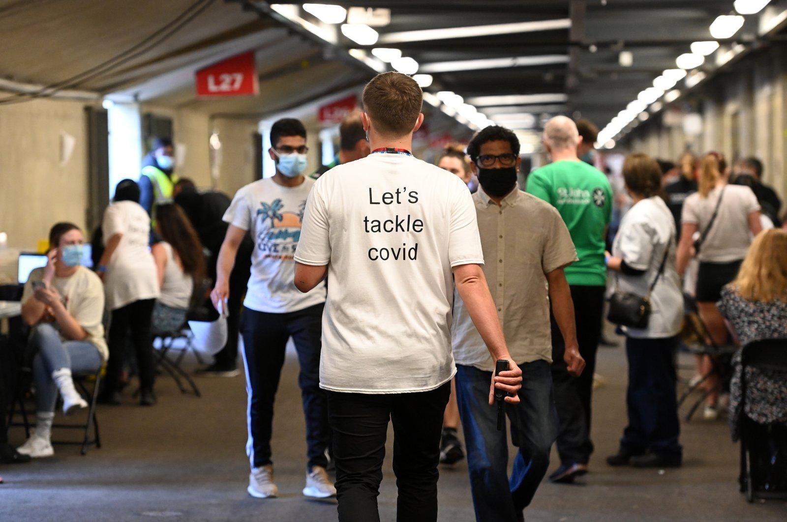 Young people wait to receive COVID-19 jabs at Twickenham Stadium in London, U.K., May 31, 2021. (EPA Photo)