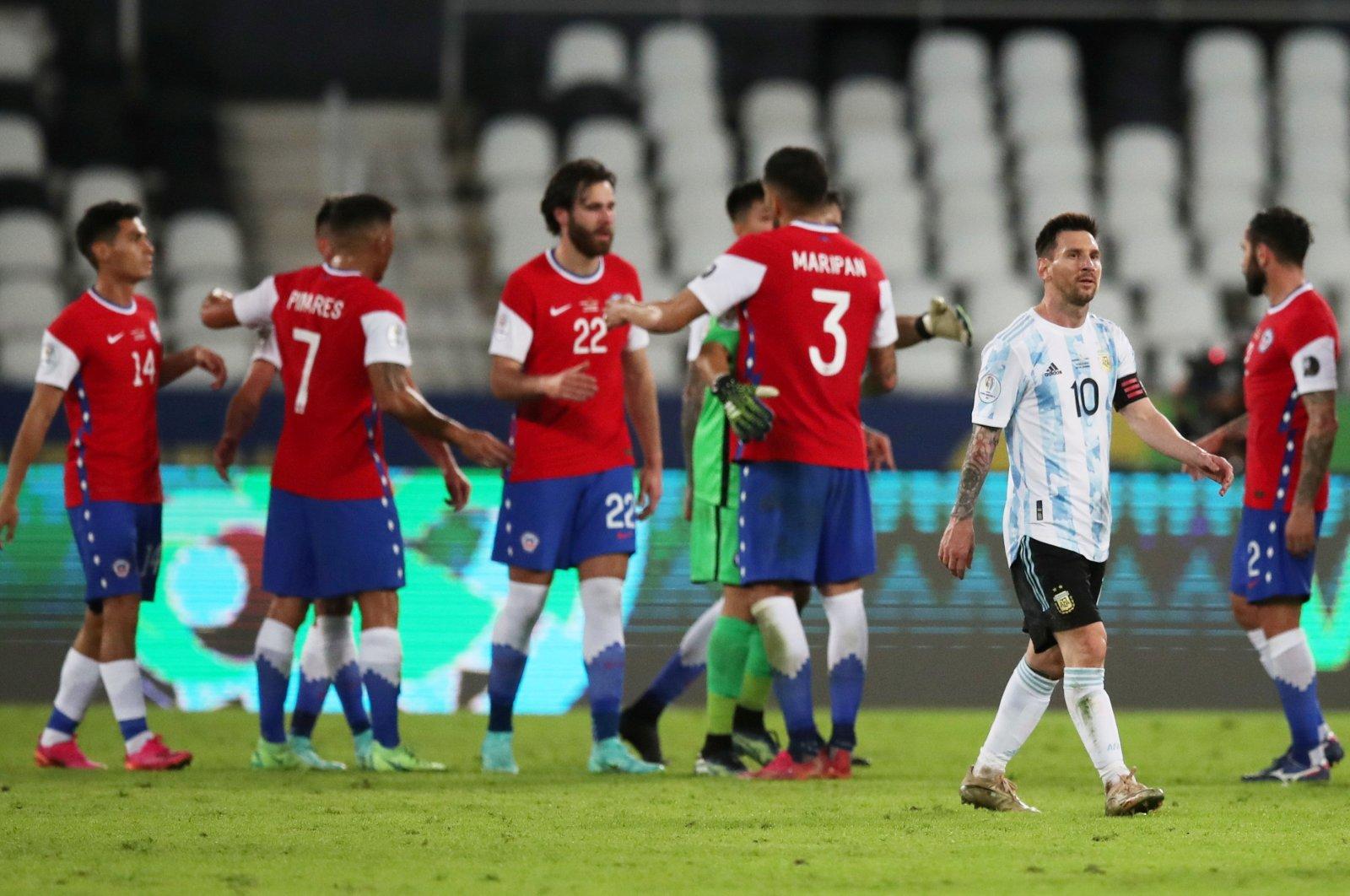 Lionel Messi (2nd R) looks dejected after Argentina's Copa America match against Chile, Estadio Nilton Santos, Rio de Janeiro, Brazil, June 14, 2021. (Reuters Photo)
