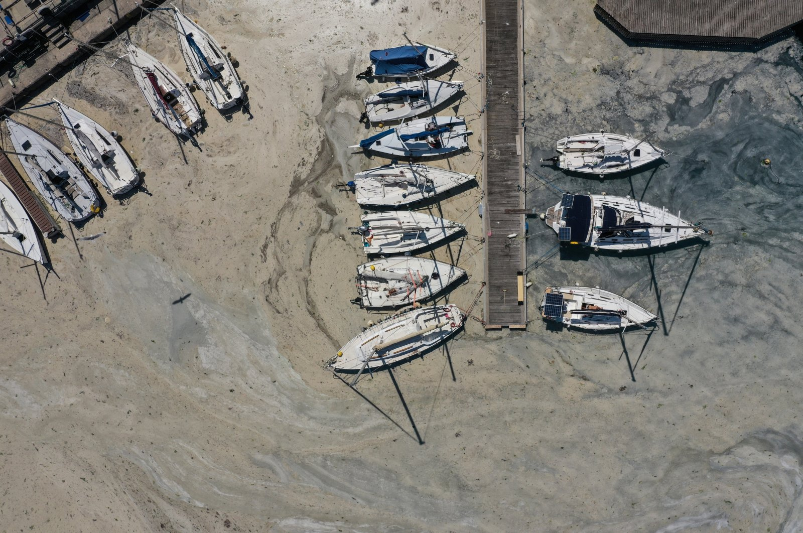 An aerial view of boats docked in a marina covered by sea snot, in Istanbul, Turkey, June 13, 2021. (REUTERS PHOTO)