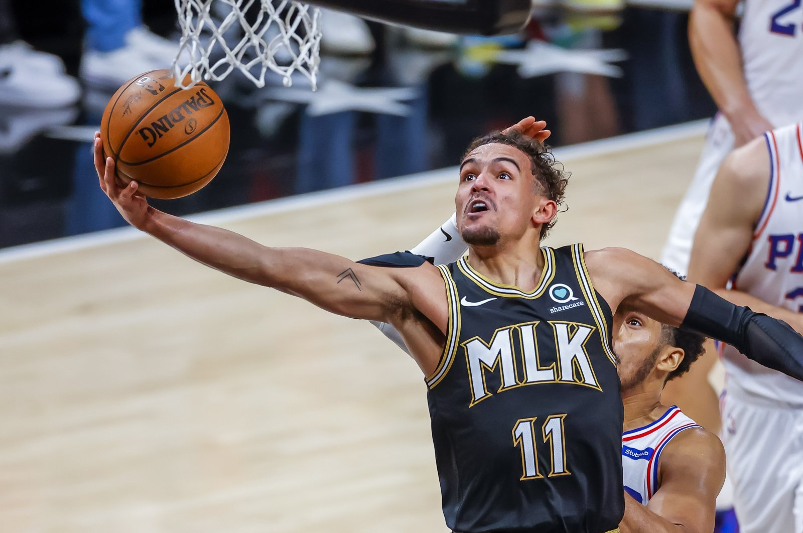Atlanta Hawks guard Trae Young (L) in action against Philadelphia 76ers forward Gary Clark (R) during Game 4 of the NBA Eastern Conference semifinal playoff series at State Farm Arena, Atlanta, Georgia, U.S., June 14, 2021. (EPA Photo)