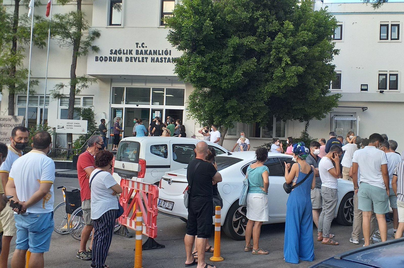 People wait outside a hospital for vaccination in Bodrum, in Muğla, southwestern Turkey, June 15, 2021. (İHA PHOTO)