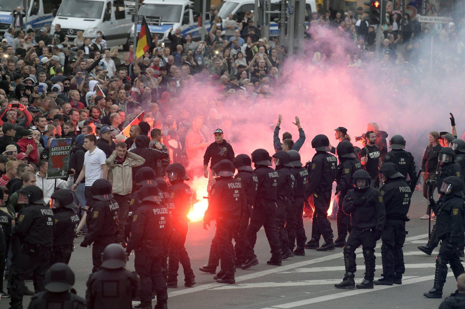 Far-right demonstrators light fireworks in Chemnitz, Germany, Aug 27, 2018. (AP Photo)