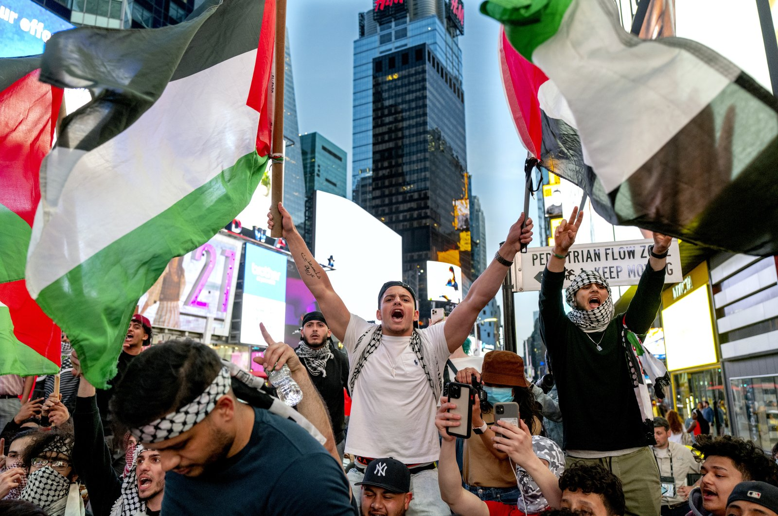 People during a demonstration against Israeli violence in occupied Palestinian territories, in the Times Square, New York City, New York, U.S., May 20, 2021. (AP Photo)