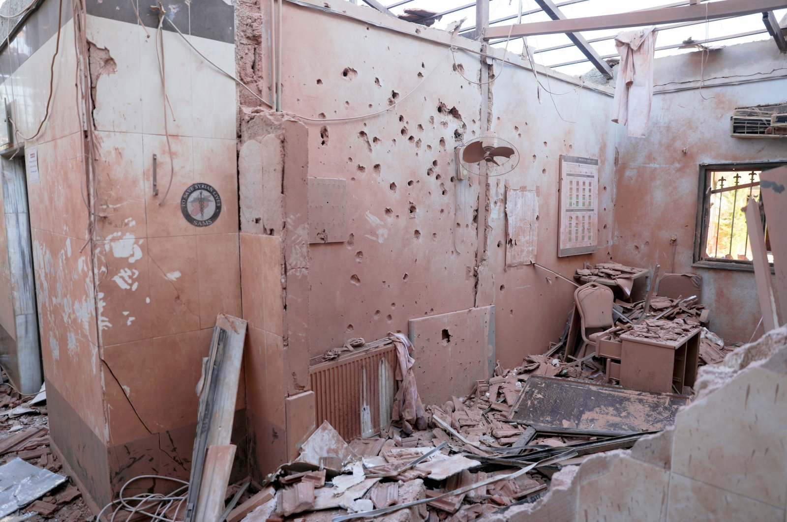 The aftermath of the attack on Al-Shifa Hospital in the city of Afrin, northern Syria, June 13, 2021. (EPA Photo)