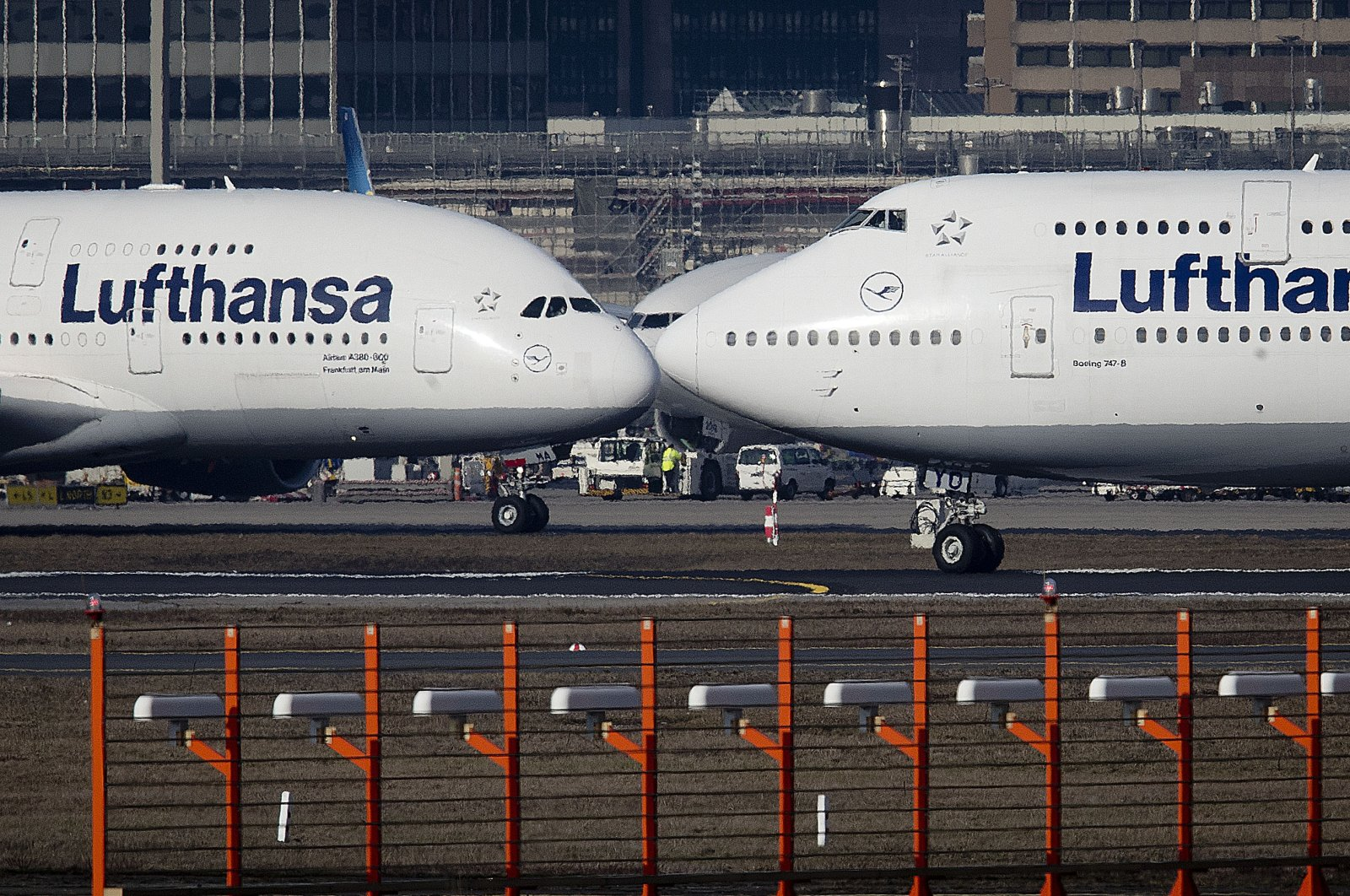 An Airbus A380 (L) and a Boeing 747, both from Lufthansa airlines, pass each other at the airport in Frankfurt, Germany, Feb.14, 2019. (AP Photo)