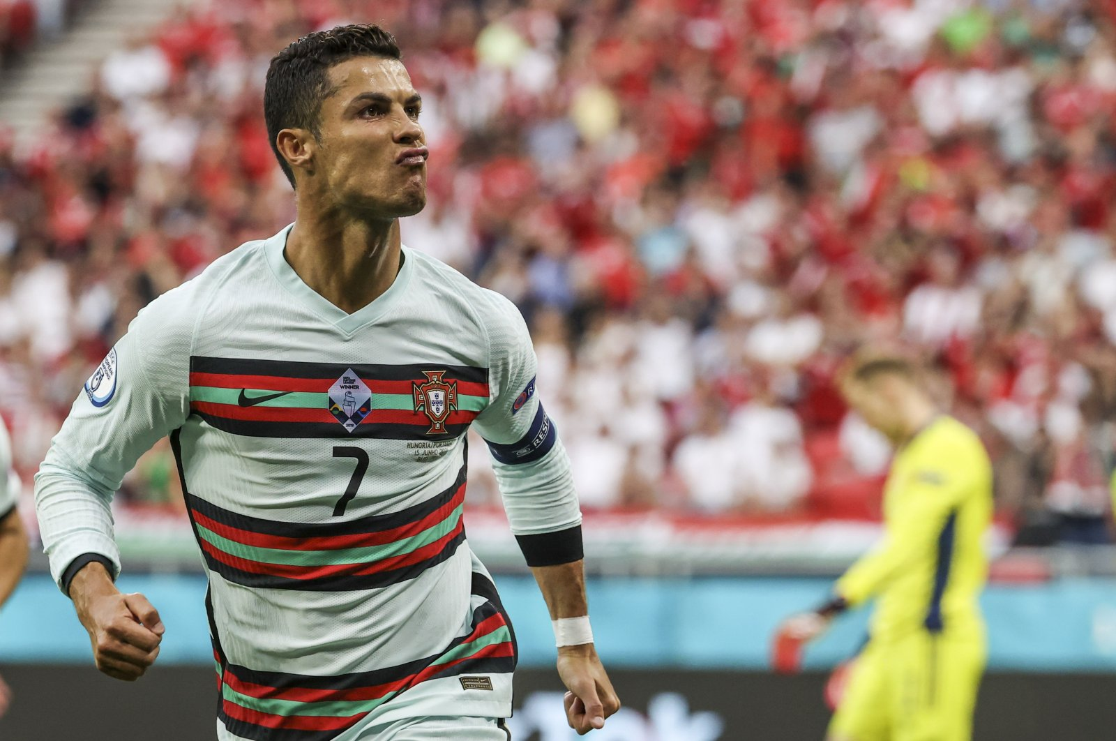 Portugal's Cristiano Ronaldo celebrates after scoring his second team goal during the Euro 2020 championship Group F match between Hungary and Portugal at Puskas Arena in Budapest, Hungary, June 15, 2021. (AP Photo)