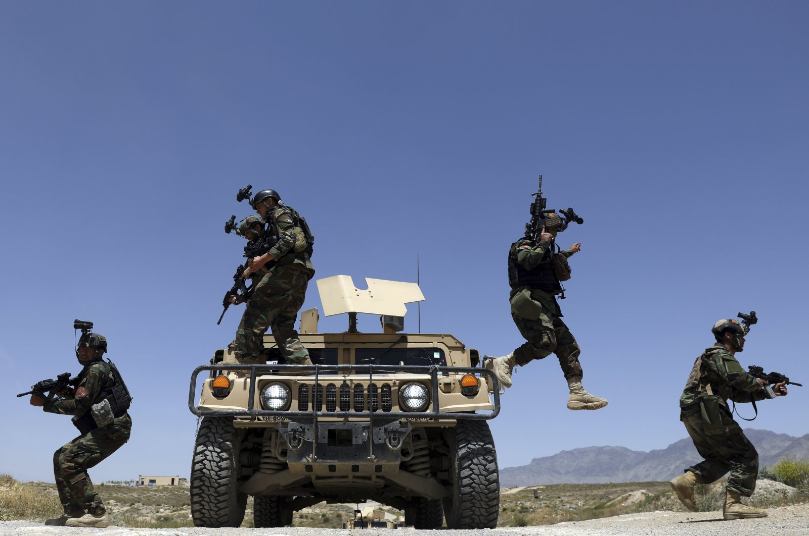 Afghan soldiers patrol outside their military base on the outskirts of Kabul, Afghanistan, May 9, 2021. (AP Photo)