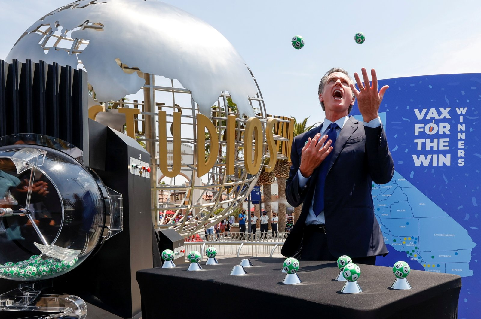 California Governor Gavin Newsom juggles the Vax for the Win lottery contest program balls at Universal Studios Hollywood in Universal City, Los Angeles, California, U.S. June 15, 2021. (Reuters Photo)