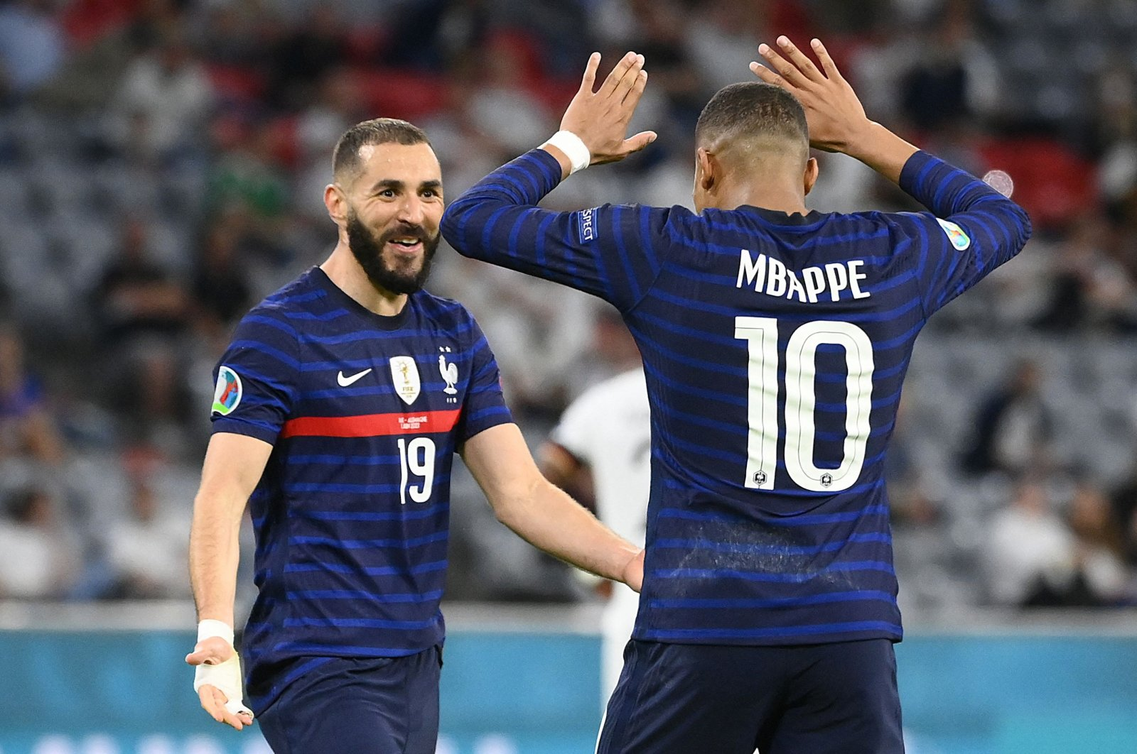 France's forward Karim Benzema (L) celebrates with France's forward Kylian Mbappe after scoring, before it was later revoked due to offside, during the UEFA EURO 2020 Group F football match between France and Germany at the Allianz Arena in Munich on June 15, 2021. (AFP Photo)