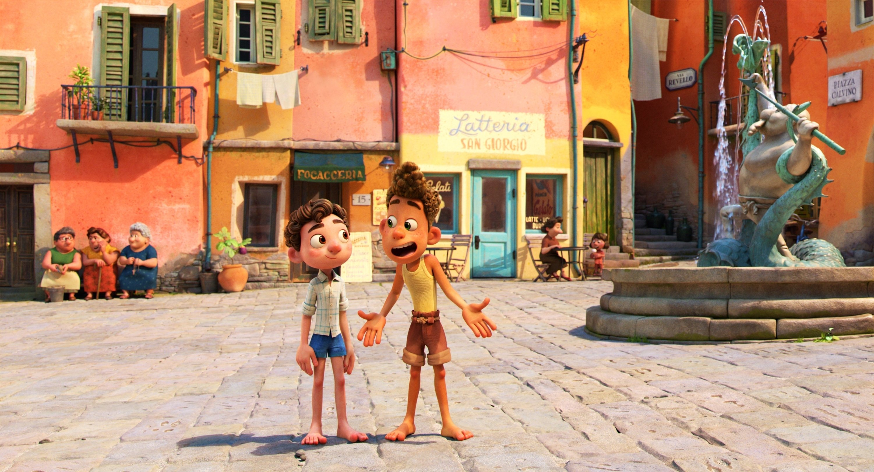 Alberto, voiced by Jack Dylan Grazer (R), and Luca, voiced by Jacob Tremblay walk in a public square in a scene from the animated film 'Luca.' (Photo by Disney via AP)