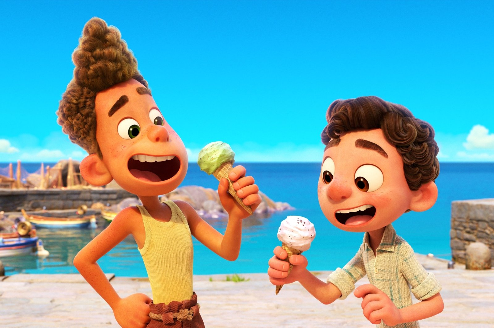 """Alberto, voiced by Jack Dylan Grazer (L), and Luca, voiced by Jacob Tremblay, eat ice cream in a scene from the animated film """"Luca."""" (Photo by Disney via AP)"""