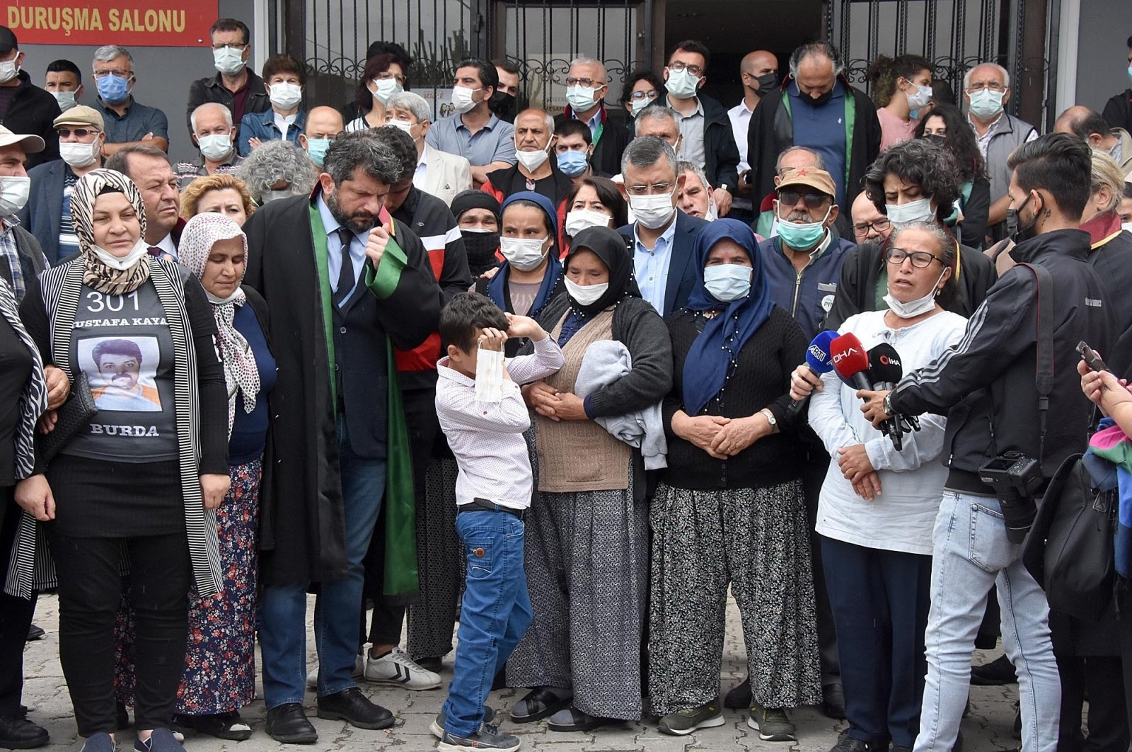 Families of the victims, lawyers and supporters, including the Republican People's Party (CHP) Group Deputy Chairperson Özgür Özel (C), make statements in front of a court in Akhisar, western Manisa province, Turkey, June 16, 2021. (DHA Photo)