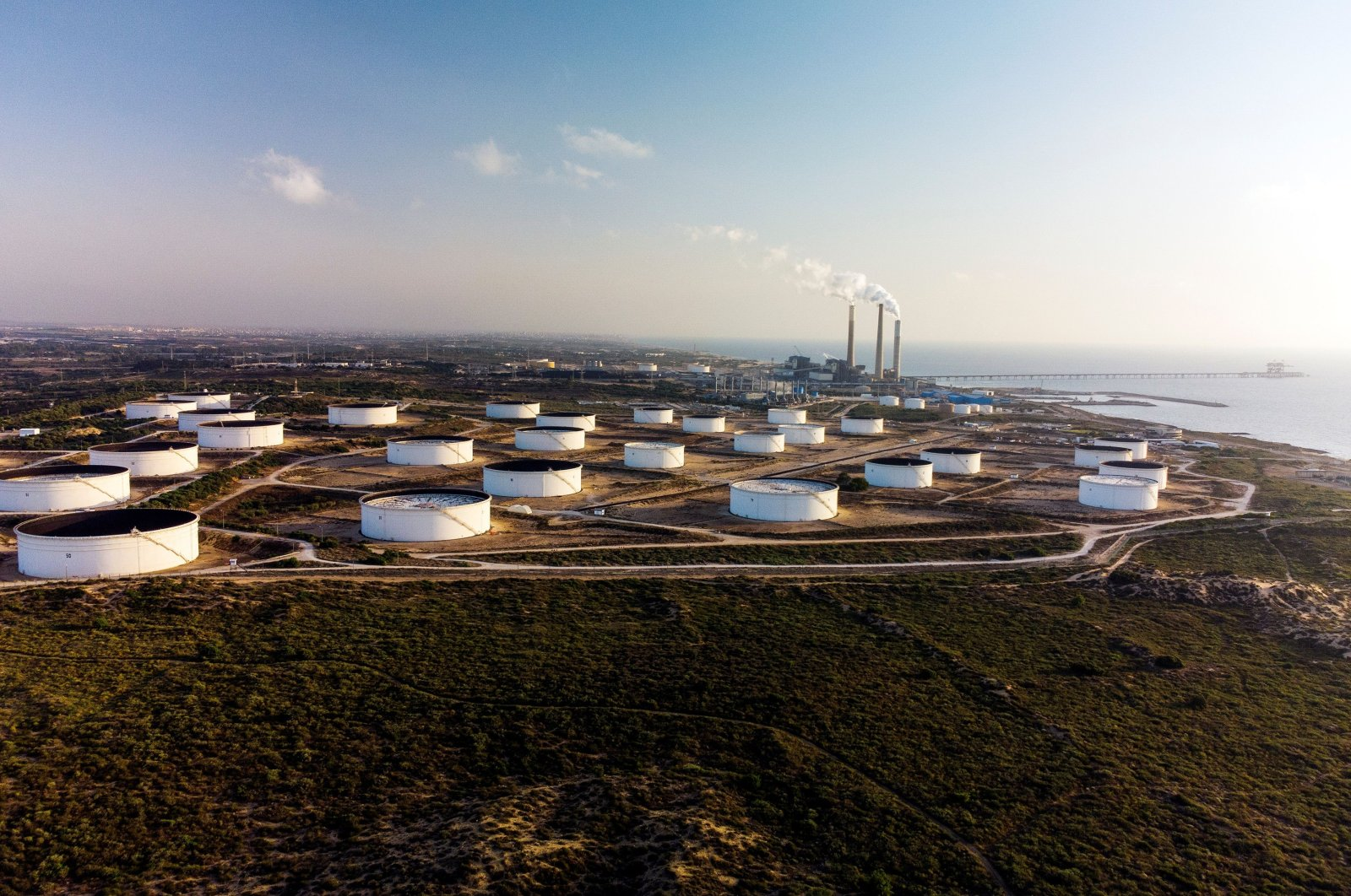 An aerial view shows storage tanks at the oil terminal of Europe Asia Pipeline Company (EAPC) off the Mediterranean coast in Ashkelon, Israel, June 10, 2021. (Reuters Photo)