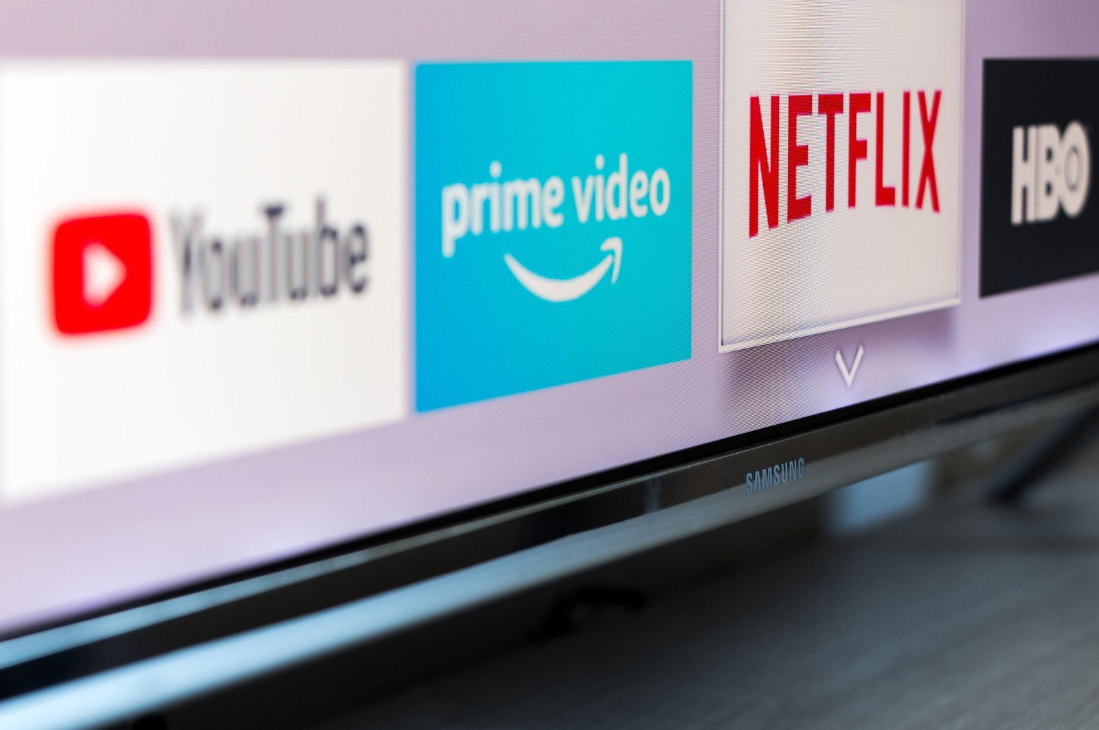 Logos of several streaming services, including YouTube, Amazon Prime Video, Netflix and HBO, are displayed on a television screen, Madrid, Spain, Aug. 13, 2018. (Shutterstock Photo)