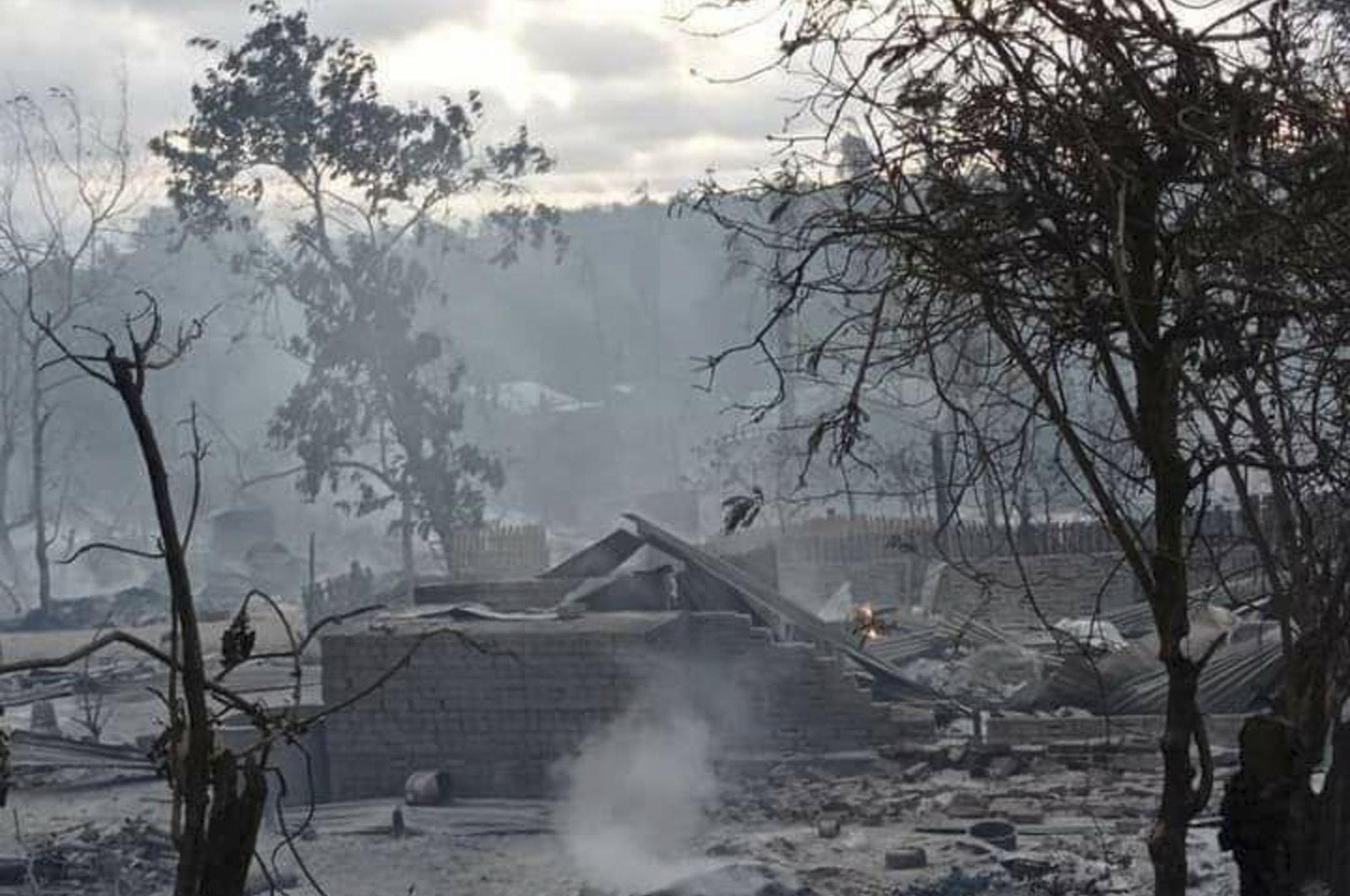 Smoke rises from smoldering houses in Kinma village, Pauk township, Magwe division, central Myanmar, June 16, 2021. (AP Photo)