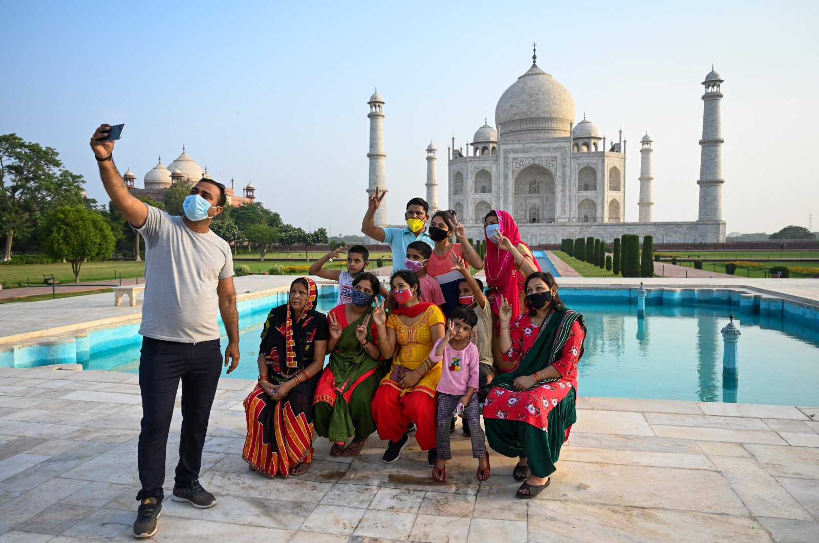 A group of tourists takes a photo at the Taj Mahal after it reopened to visitors following authorities easing coronavirus restrictions in Agra, India, June 16, 2021. (AFP Photo)