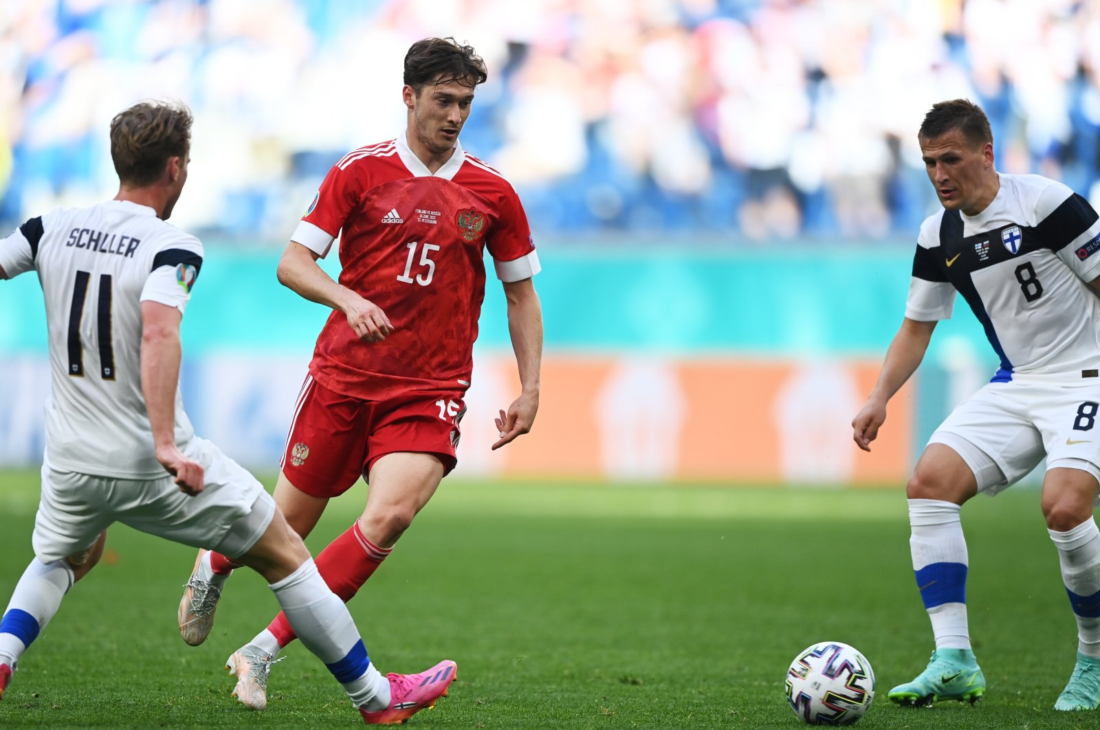 Russia's Aleksei Miranchuk (C) in action during a Euro 2020 match against Finland, in St. Petersburg, Russia, June 16, 2021. (EPA Photo)