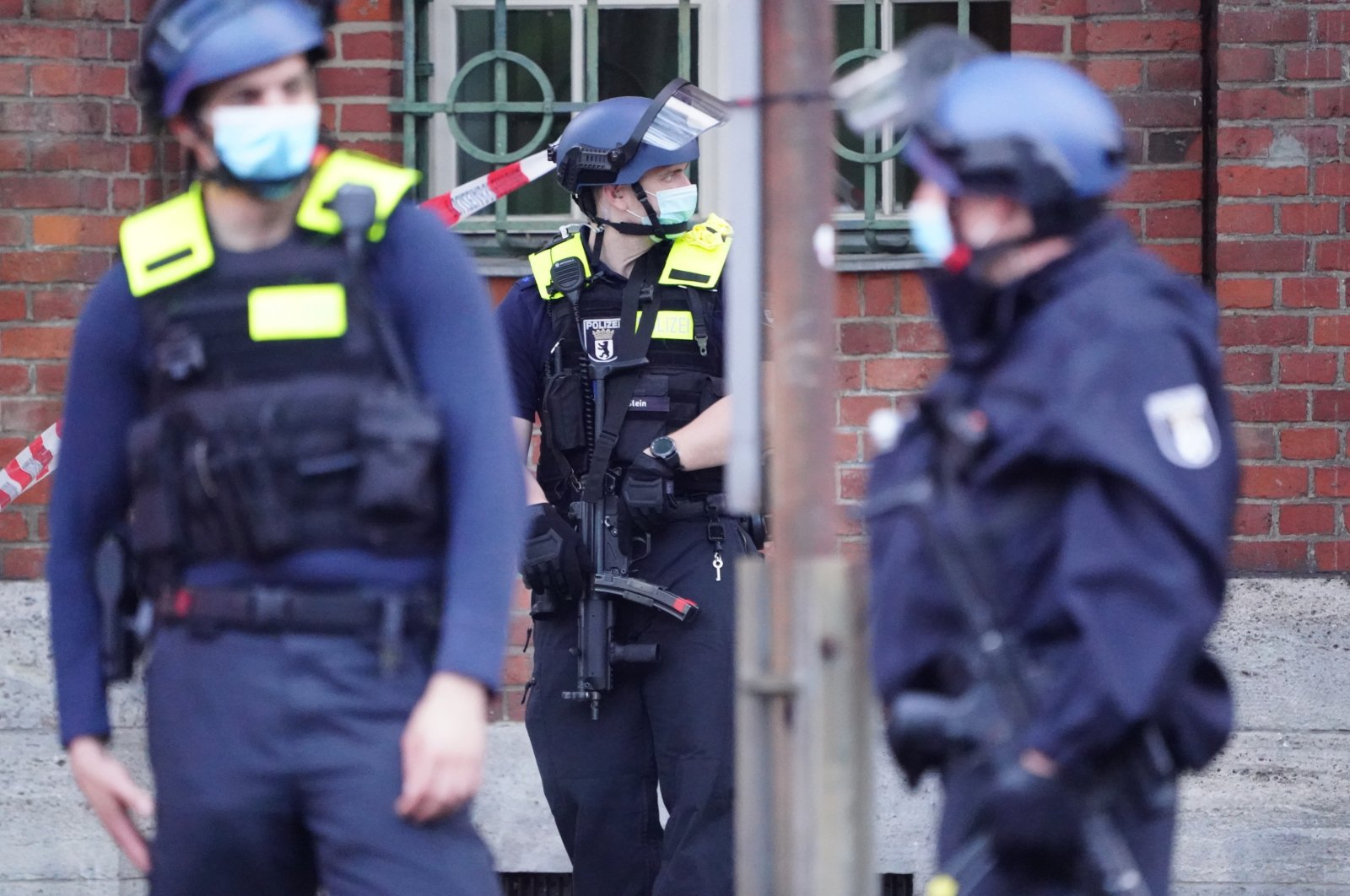 Armed policemen stand in front of the Senate Department for Health, Care and Equality building, in Berlin, Germany, 01 June 2021. (EPA Photo)