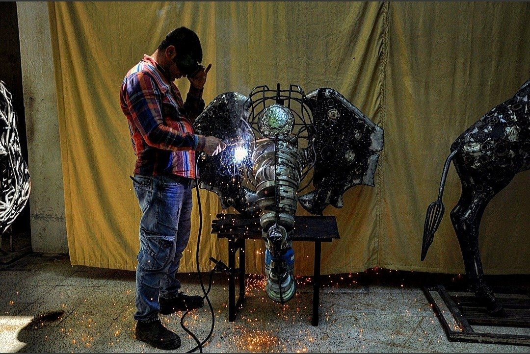 Mervan Altınorak, a mosaic and sculpture artist, works on a sculpture of an elephant created with scrap metals, Hatay, Turkey, June 16, 2021. (IHA Photo)