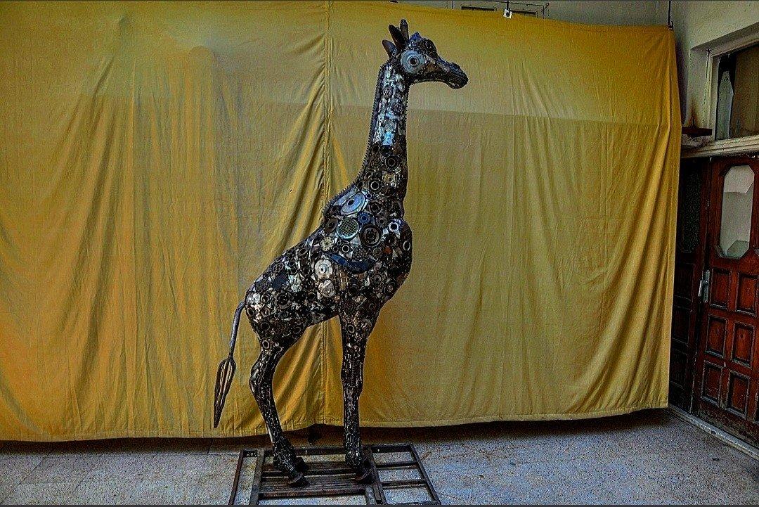 A sculpture of a giraffe created with scrap metals by Mervan Altınorak, a mosaic and sculpture artist, Hatay, Turkey, June 16, 2021. (IHA Photo)