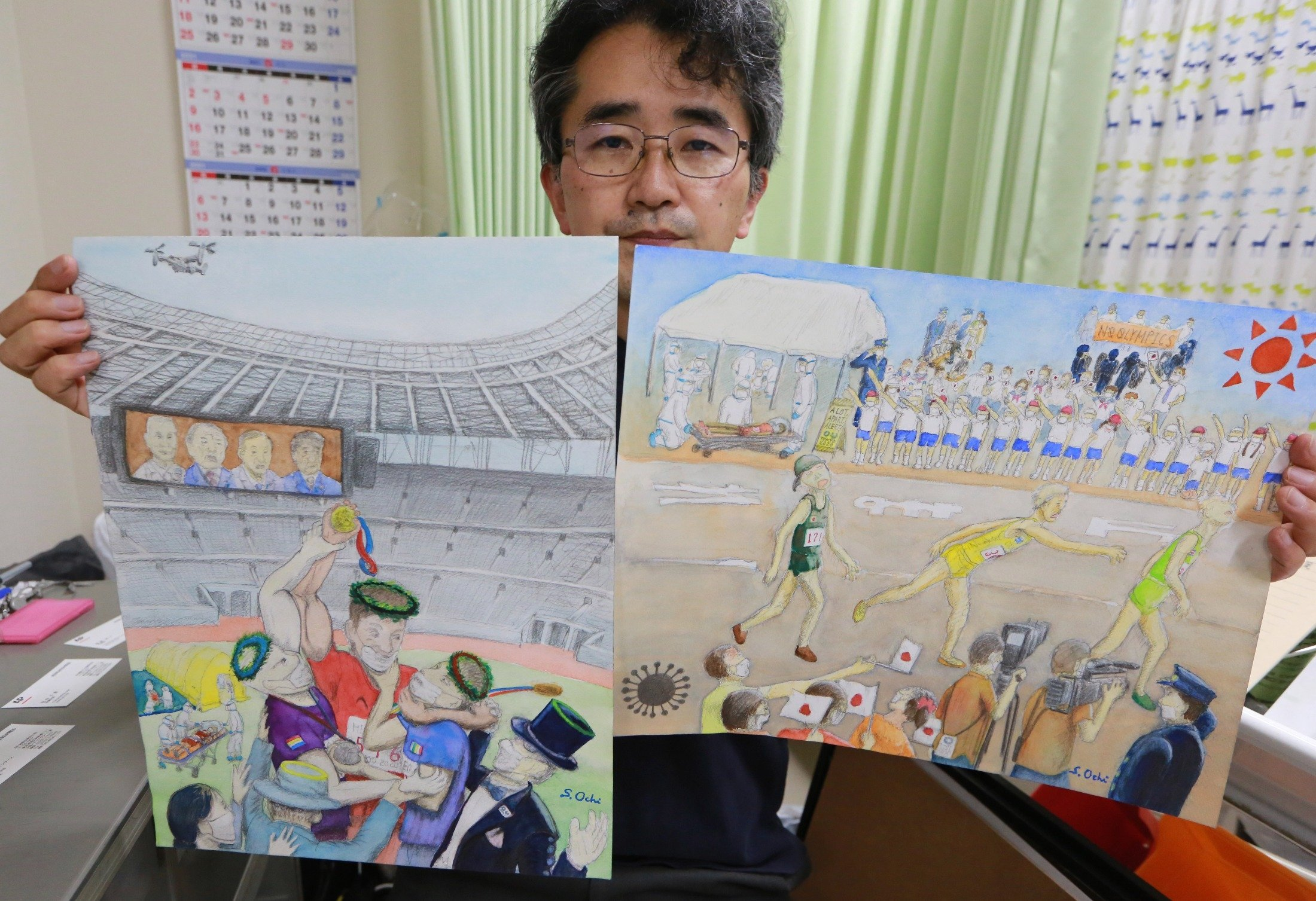 Doctor Sachihiro Ochi holds his work during an interview with The Associated Press in Yokohama near Tokyo, Japan, June 15, 2021. (AP Photo)