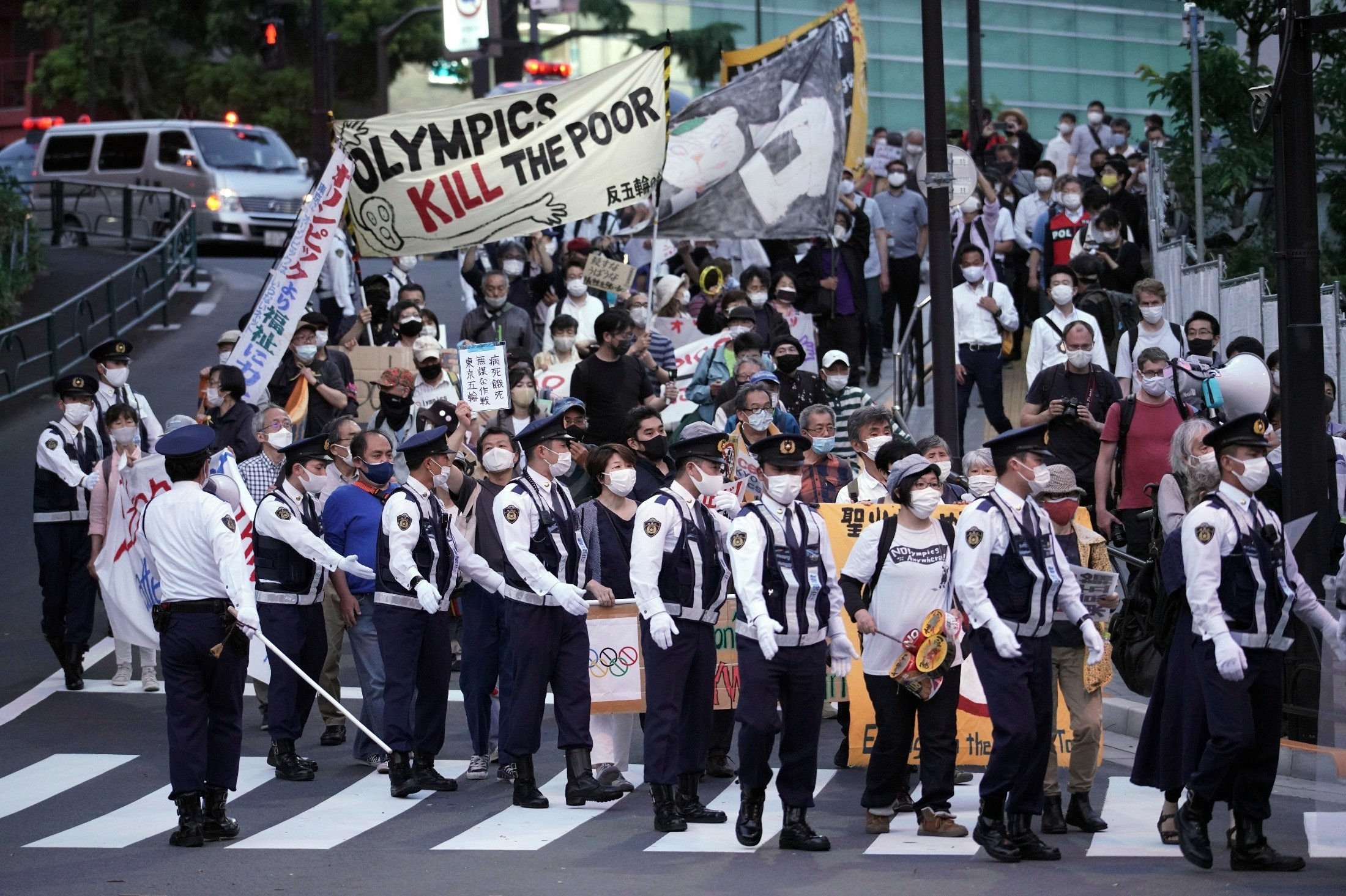 People against the Tokyo 2020 Olympics set to open in July, march to protest around Tokyo's National Stadium during an anti-Olympics demonstration, Tokyo, Japan, May 9, 2021. (AP Photo)