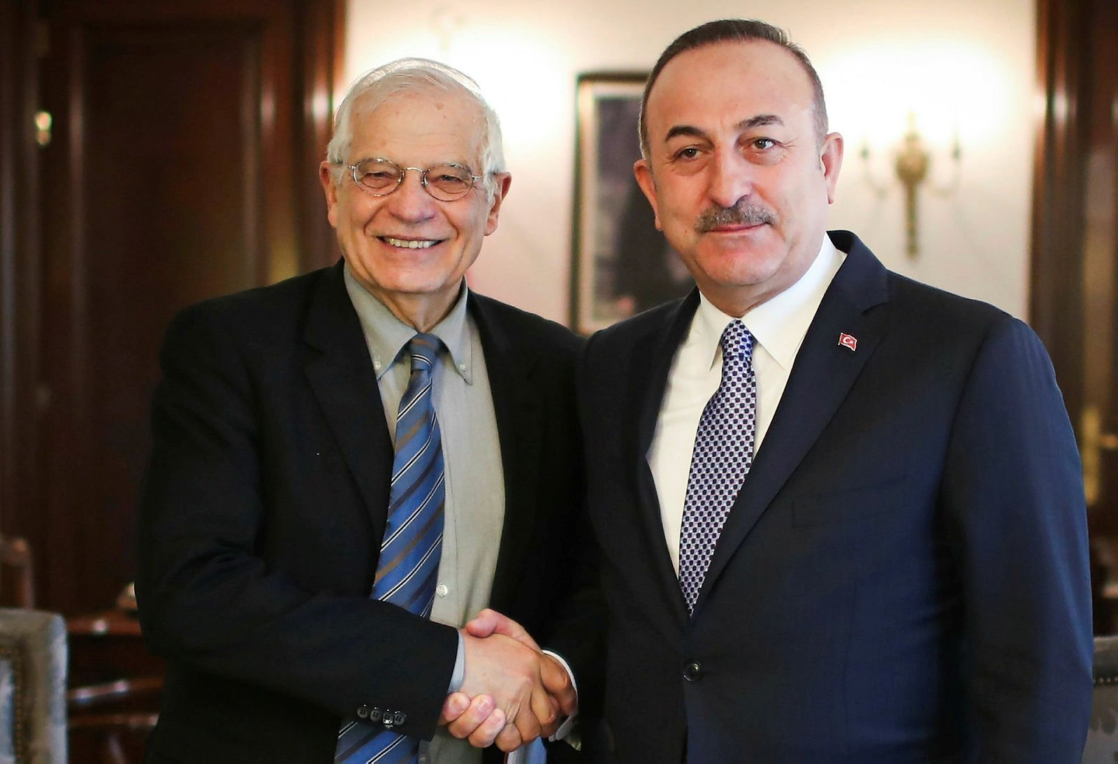 European Union Minister for Foreign Affairs Josep Borrell (L) and Turkey's Foreign Minister Mevlüt Çavuşoğlu shake hands in an undated photo. (AA Photo)