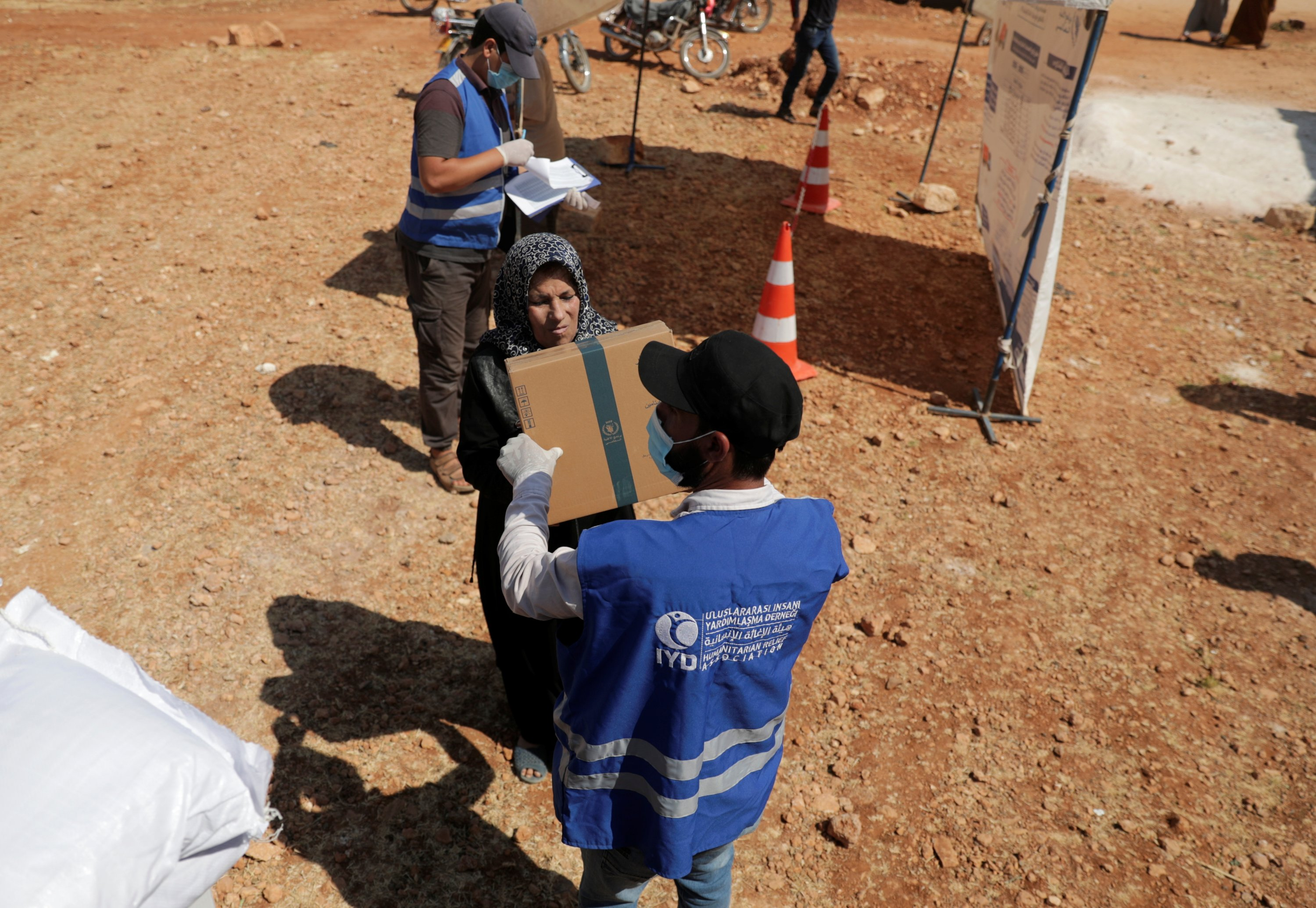 An internally displaced Syrian woman receives a parcel of humanitarian aid in the opposition-held Idlib, Syria, June 9, 2021. (Reuters Photo)
