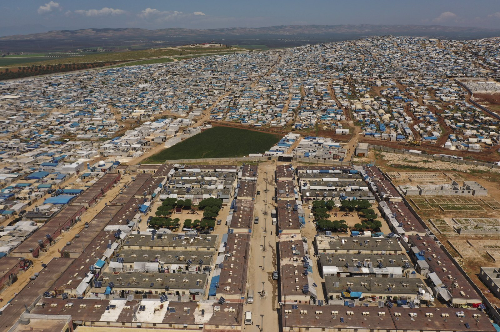 A large refugee camp on the Syrian side of the border with Turkey, near the town of Atma, in Idlib province, Syria, April 19, 2021. (AP Photo)