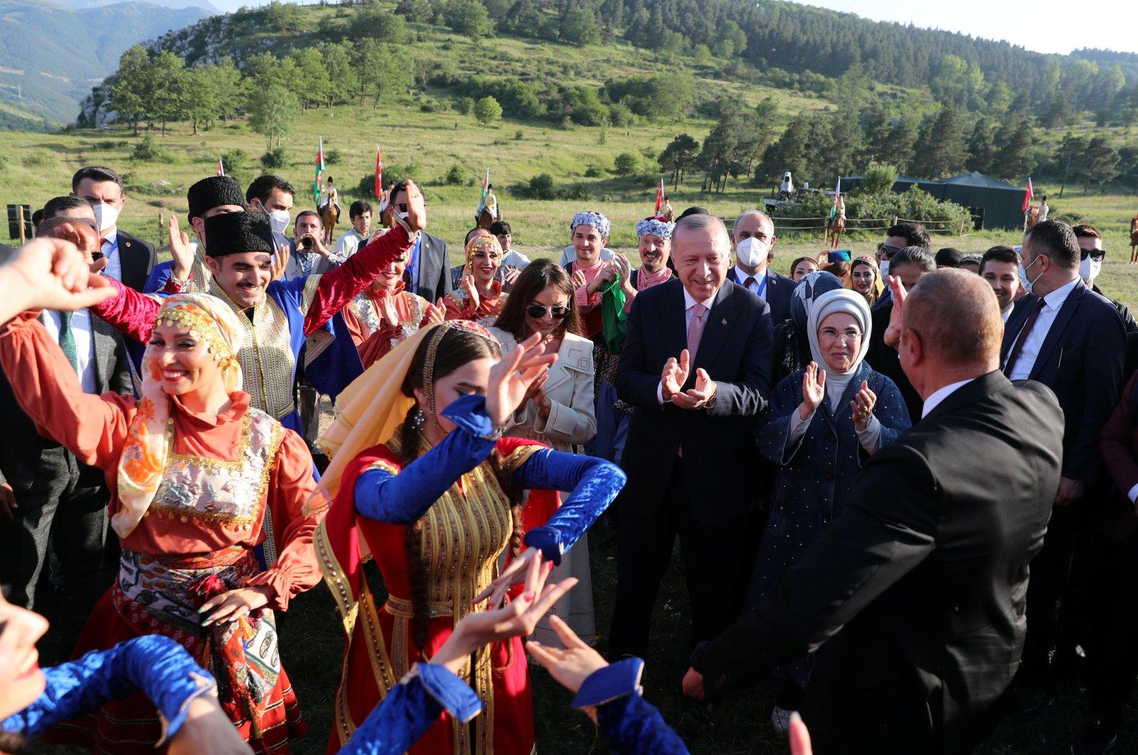 President Recep Tayyip Erdoğan (3rd R) and Azerbaijan's President Ilham Aliyev (R), accompanied by their wives Emine Erdoğan (2nd R) and Mehriban Aliyeva (4th R), attend a local festival in Shusha in the Nagorno-Karabakh region, Azerbaijan, June 15, 2021. (Retuers Photo)