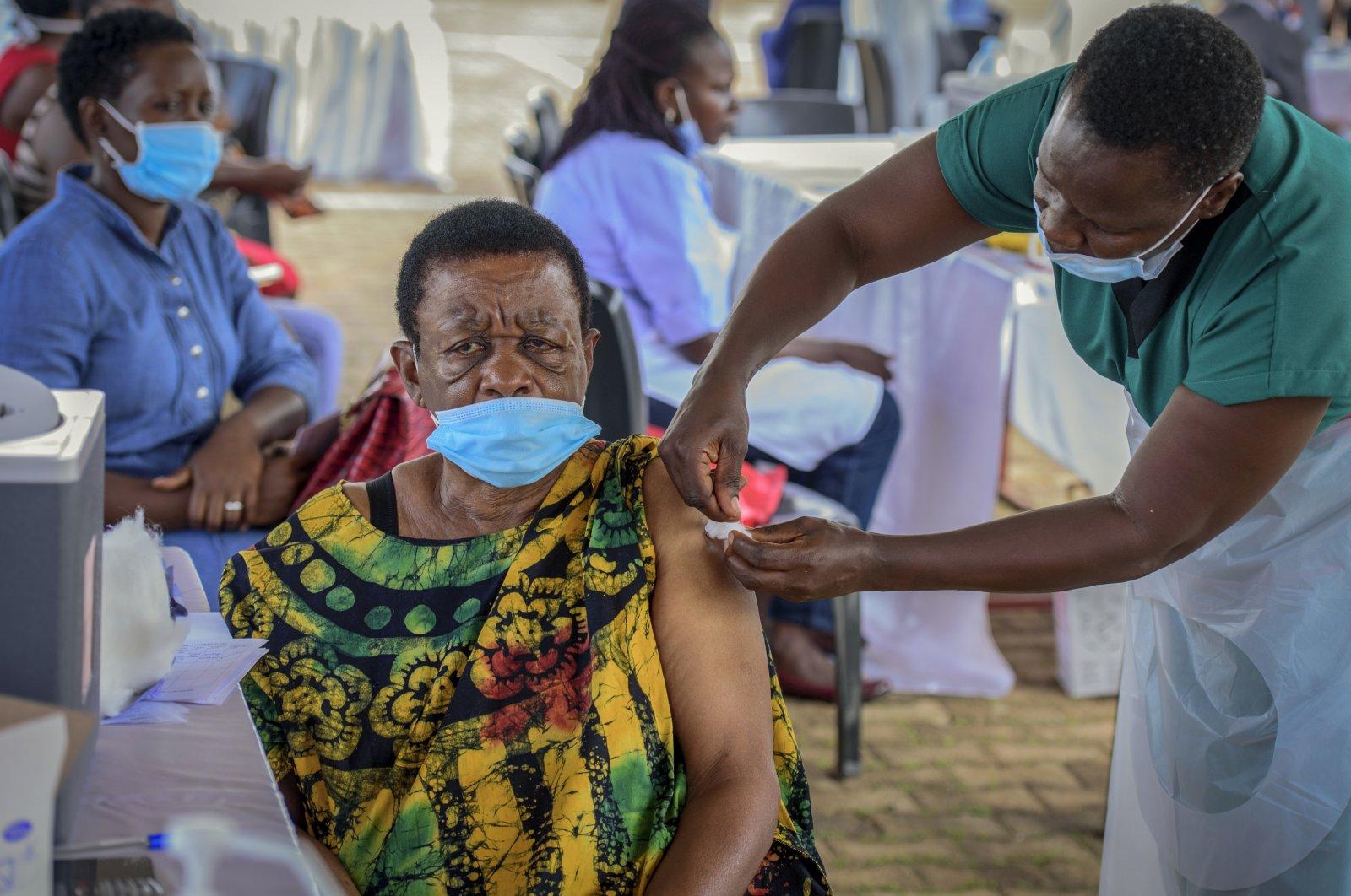 A woman receives a coronavirus vaccination at the Kololo airstrip in Kampala, Uganda, May 31, 2021. (AP Photo)