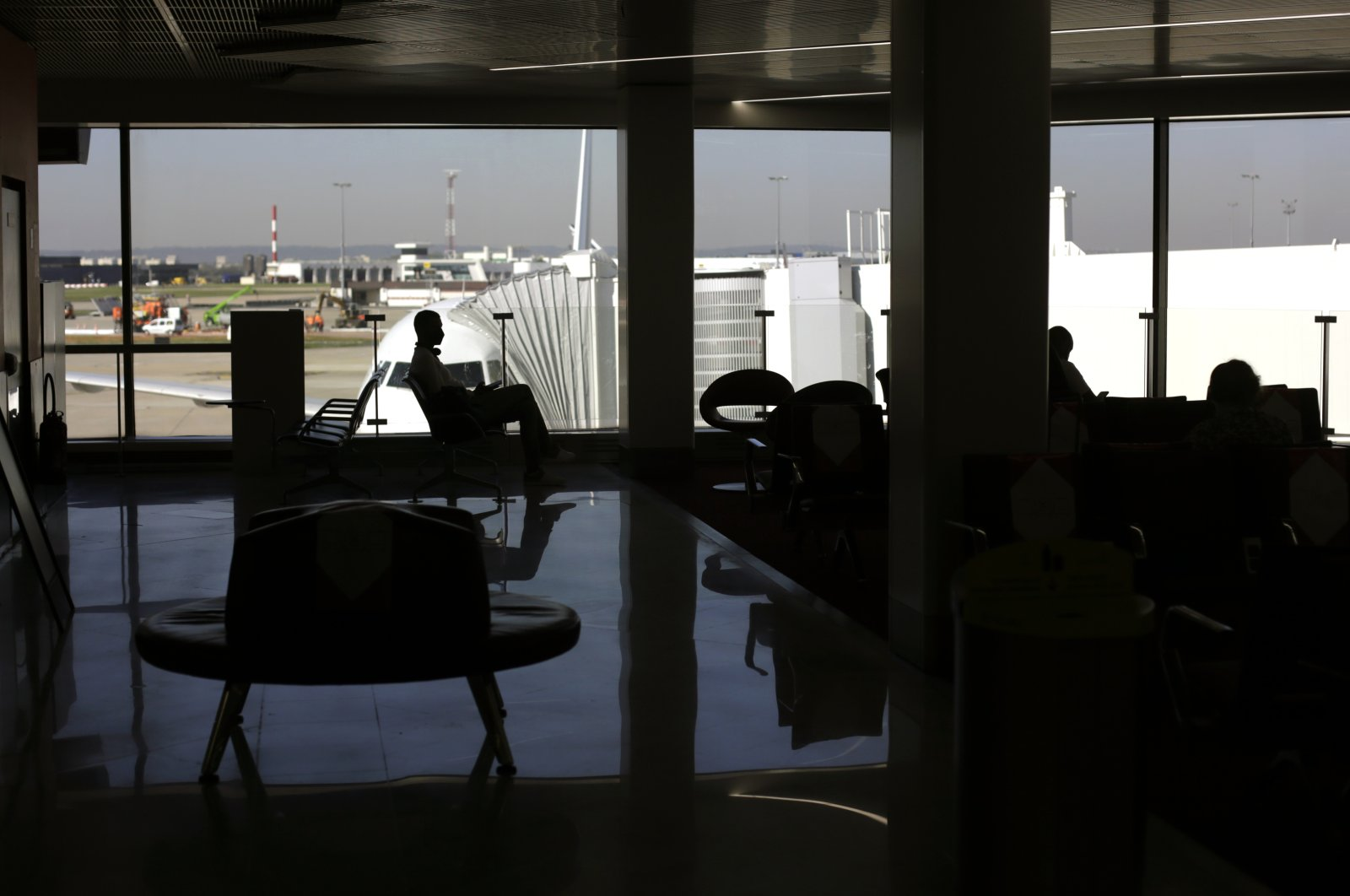 A passenger waits to board at the Paris-Orly airport, in Orly, south of Paris, France, April 27, 2021. (AP Photo)