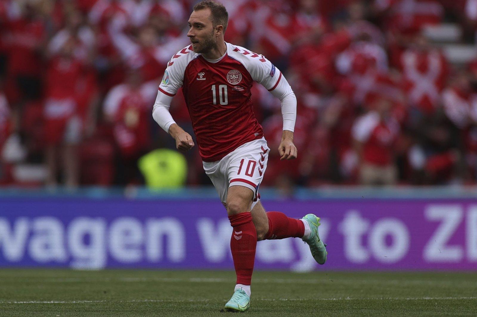 Denmark's Christian Eriksen runs during the Euro 2020 Group B match against Finland at Parken stadium in Copenhagen, Denmark, June 12, 2021. (AP Photo)