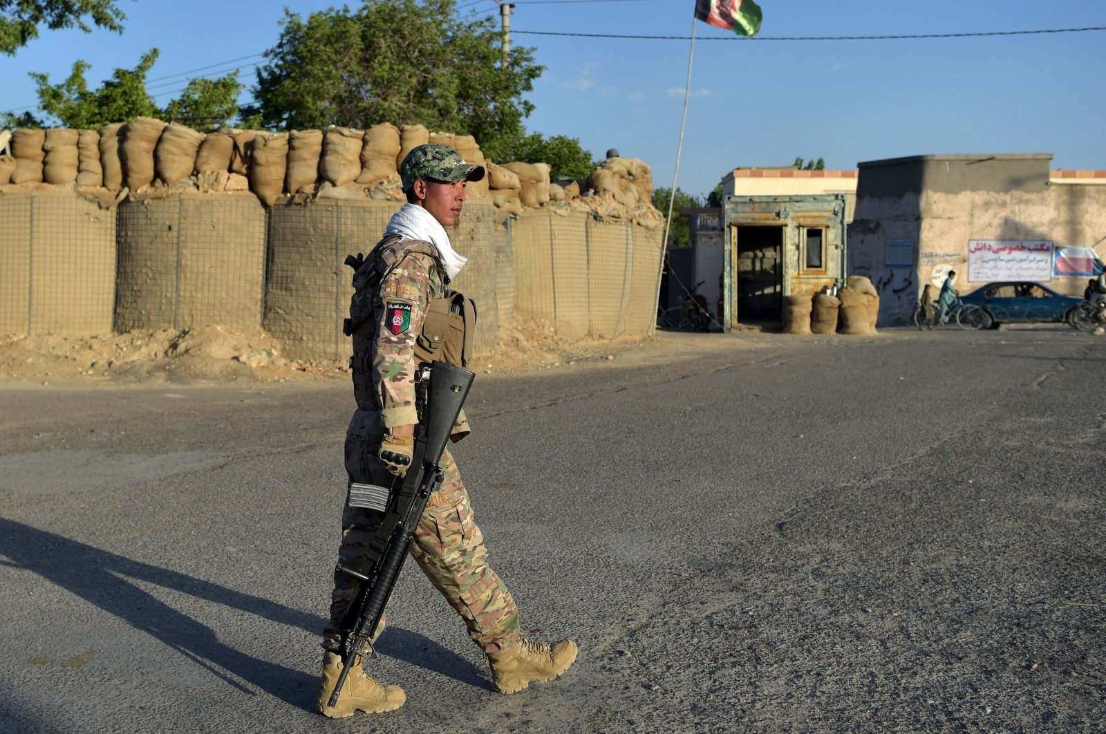 A policeman walks outside his outpost along a roadside in Ghazni, Afghanistan, June 3, 2021. (AFP Photo)