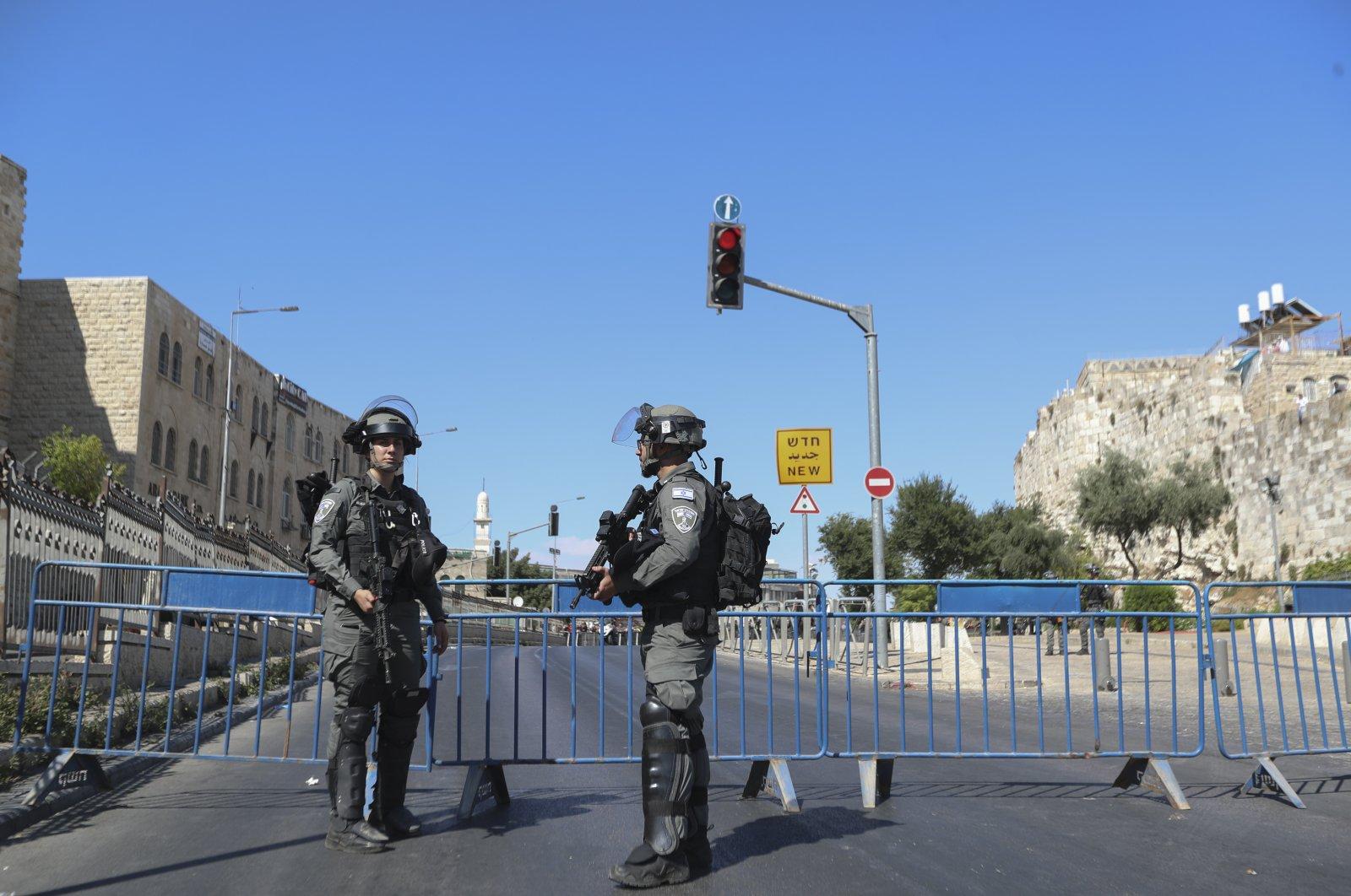 Israeli border police block a main road outside Jerusalem's Old City, June 15, 2021. (AP Photo)
