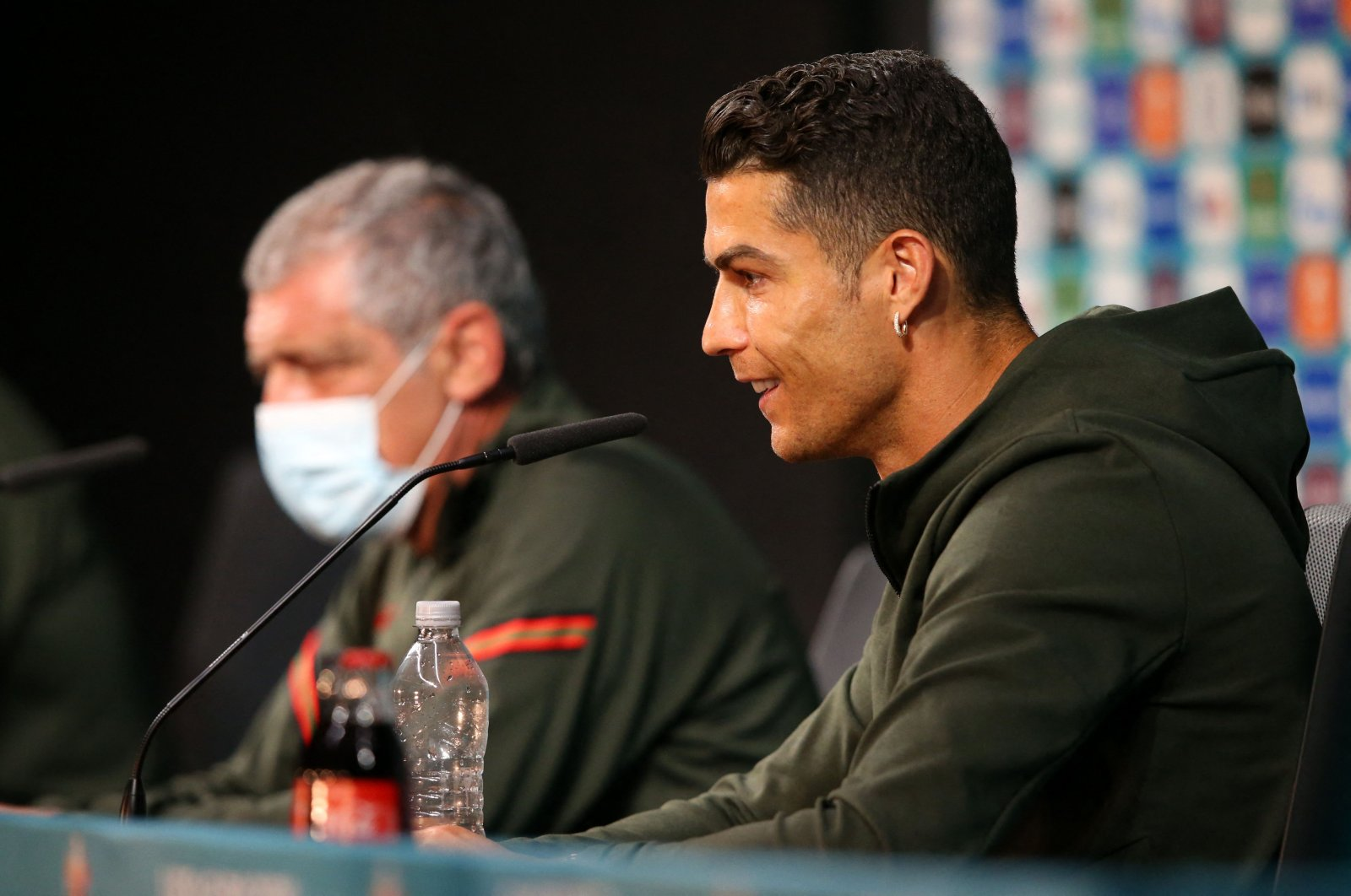 Portugal's forward Cristiano Ronaldo (R) and Portugal's coach Fernando Santos speak during a news conference at the Puskas Arena in Budapest, Hungary, June 14, 2021. (UEFA via AFP)
