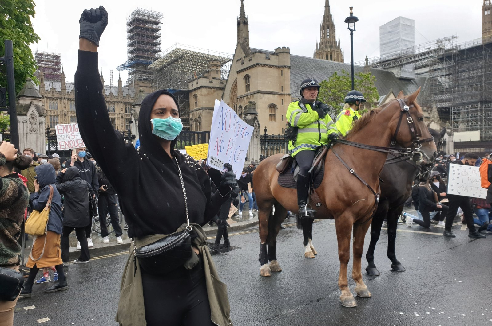 Mounted police watch demonstrators during a Black Lives Matter protest in Parliament Square, following the death of George Floyd who died in police custody in Minneapolis, in London, Britain, June 6, 2020. (Reuters Photo)