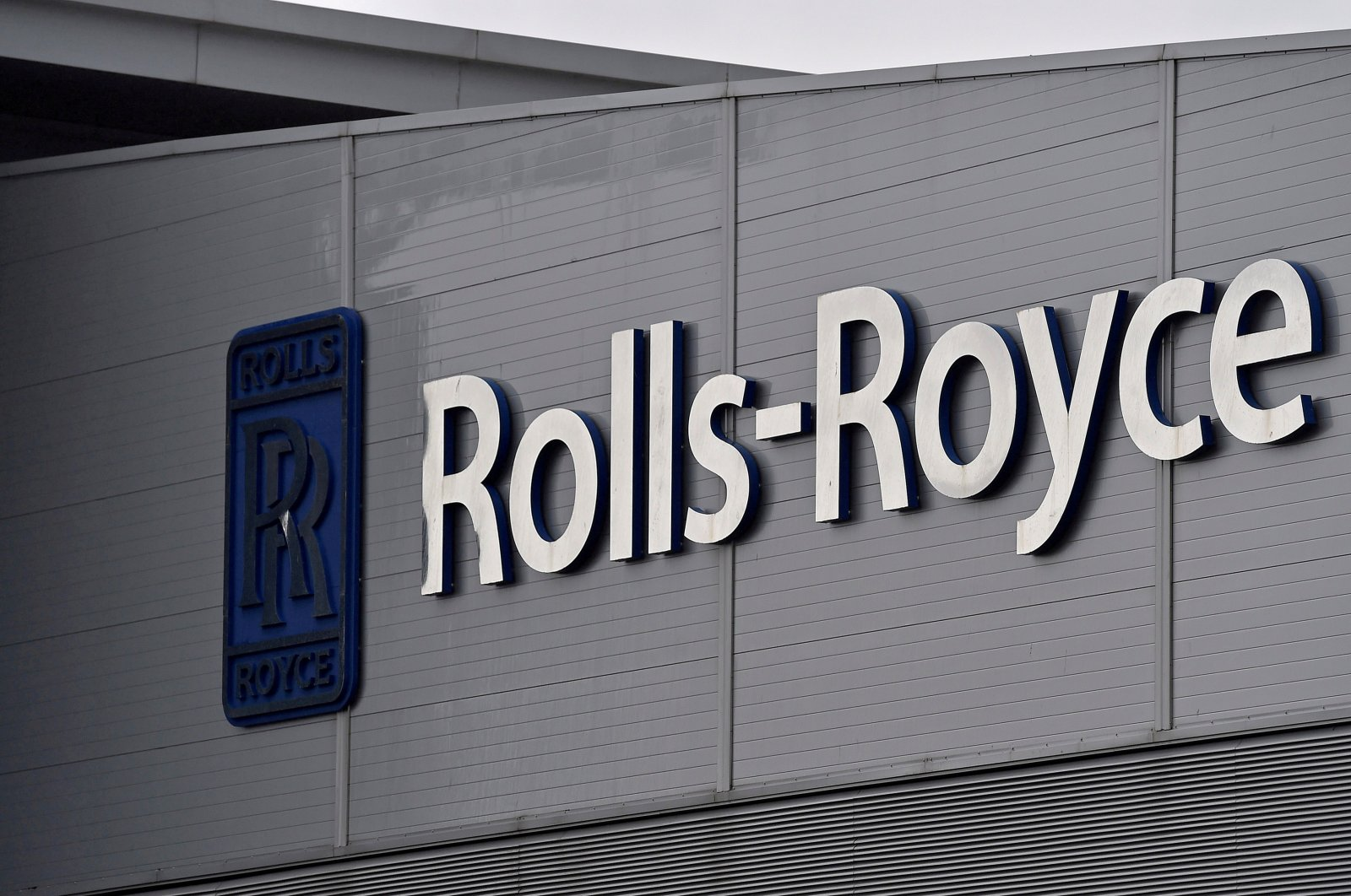 A Rolls-Royce logo hangs at the company's aerospace engineering and development site in Bristol, Britain, Dec. 17, 2015. (Reuters Photo)