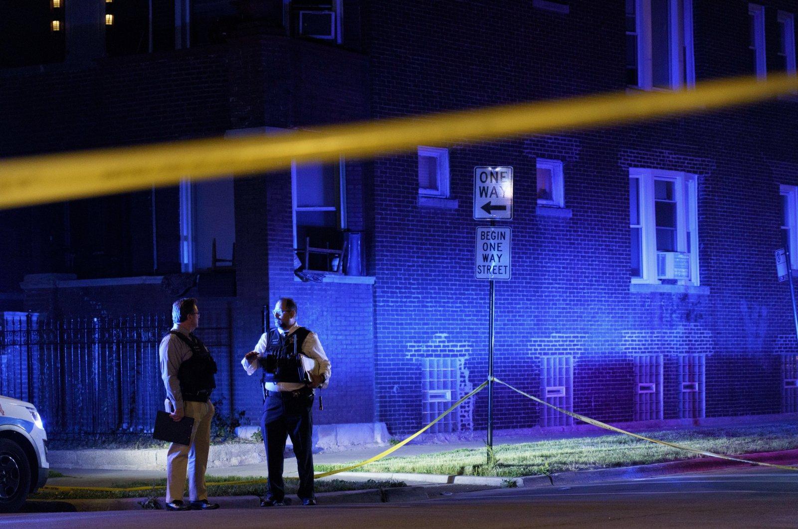 Police work the scene of a shooting in the East Garfield Park neighborhood, Chicago, U.S., June 15, 2021. (Armando L. Sanchez/Chicago Tribune via AP)
