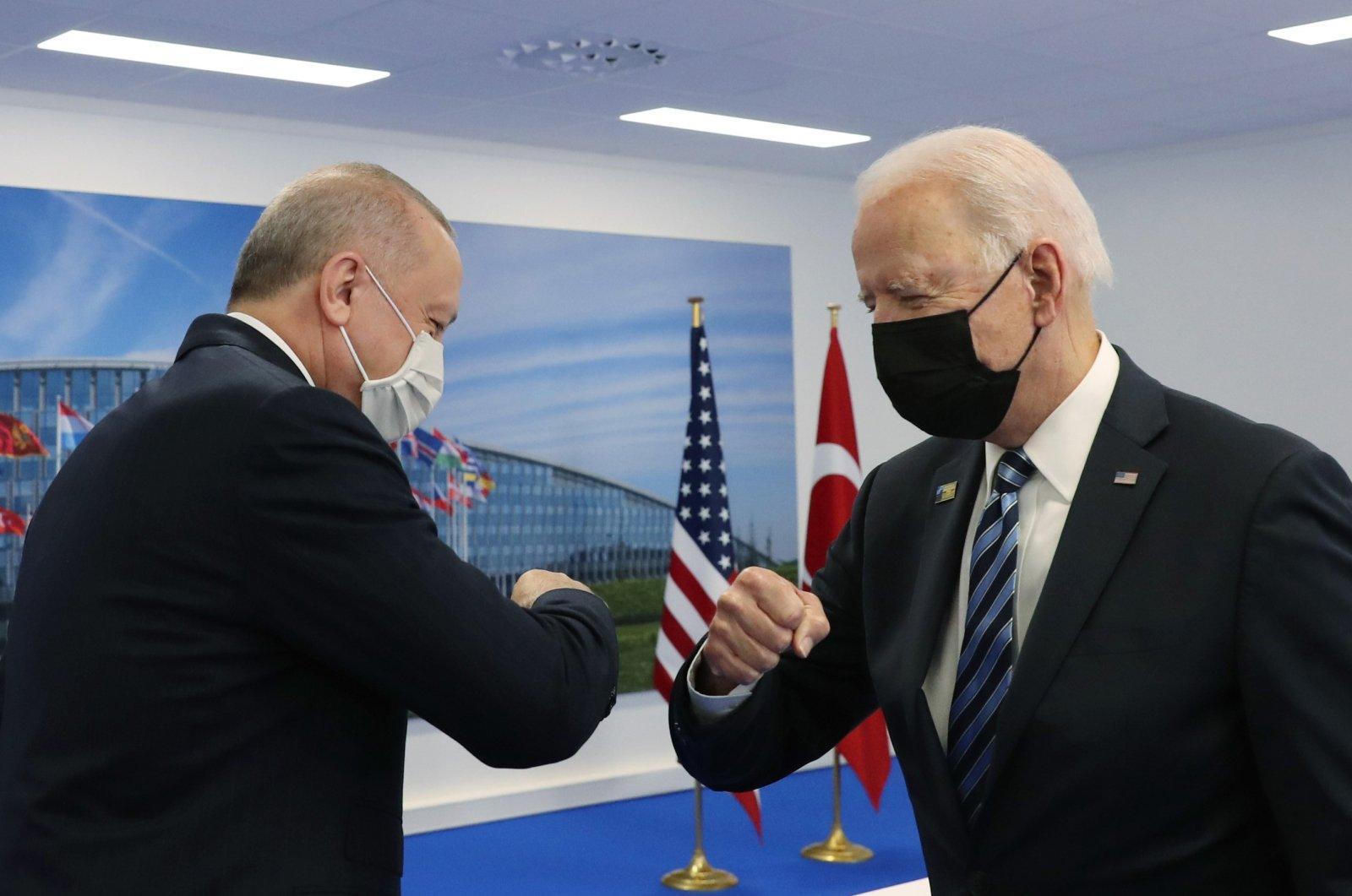 President Recep Tayyip Erdoğan and U.S. President Joe Biden greet each other in Brussels, Belgium, June 14, 2021. (IHA Photo)