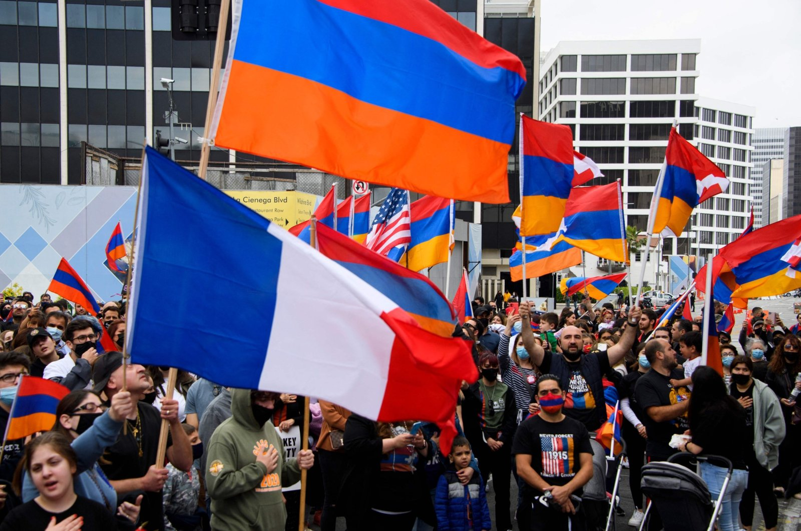 A French flag is waved alongside Armenian flags as people protest outside of the Turkish Consulate on the anniversary of the 1915 events in a demonstration organized by the Armenian Youth Federation (AYF) in Beverly Hills, California, U.S., April 24, 2021. (AFP File Photo)
