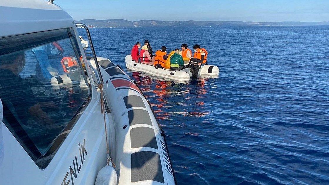 A coast guard boat helps irregular immigrants off the coast of Ayvalık, in Balıkesir, western Turkey, June 5, 2021. (AA PHOTO)