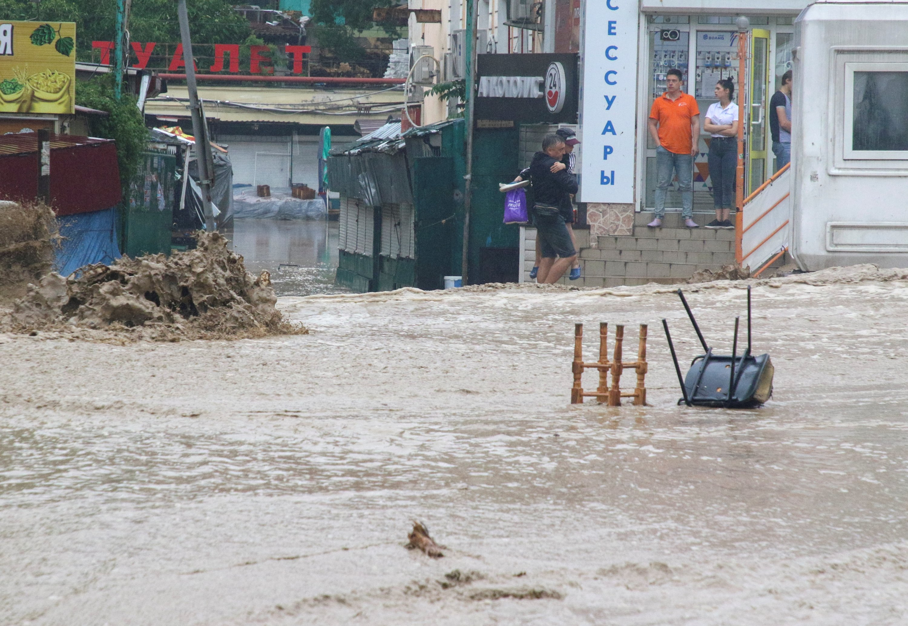 Water flows along a street after heavy rain caused flooding in Yalta, Crimea, Ukraine, June 18, 2021. (Reuters Photo)