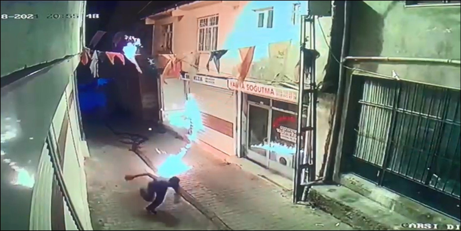 A suspect flees the scene of an attack after throwing Molotov cocktails at the ruling Justice and Development Party's (AK Party) headquarters, in a screengrab from security footage, Hani district, Diyarbakır, southeast Turkey, June 18, 2021. (DHA Photo)