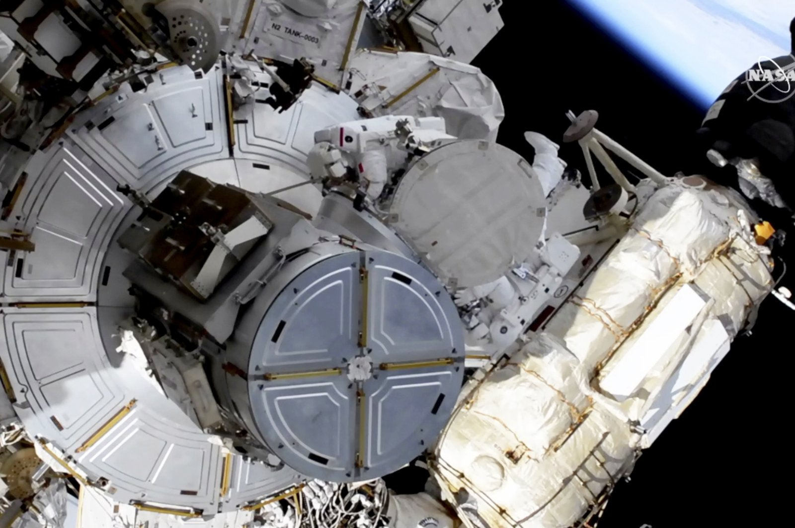 French astronaut Thomas Pesquet (T-C), and NASA astronaut Shane Kimbrough venture out on a spacewalkto outfit the International Space Station with powerful, new solar panels to handle the growing electrical demands from upcoming visitors, June 16, 2021. (NASA via AP)