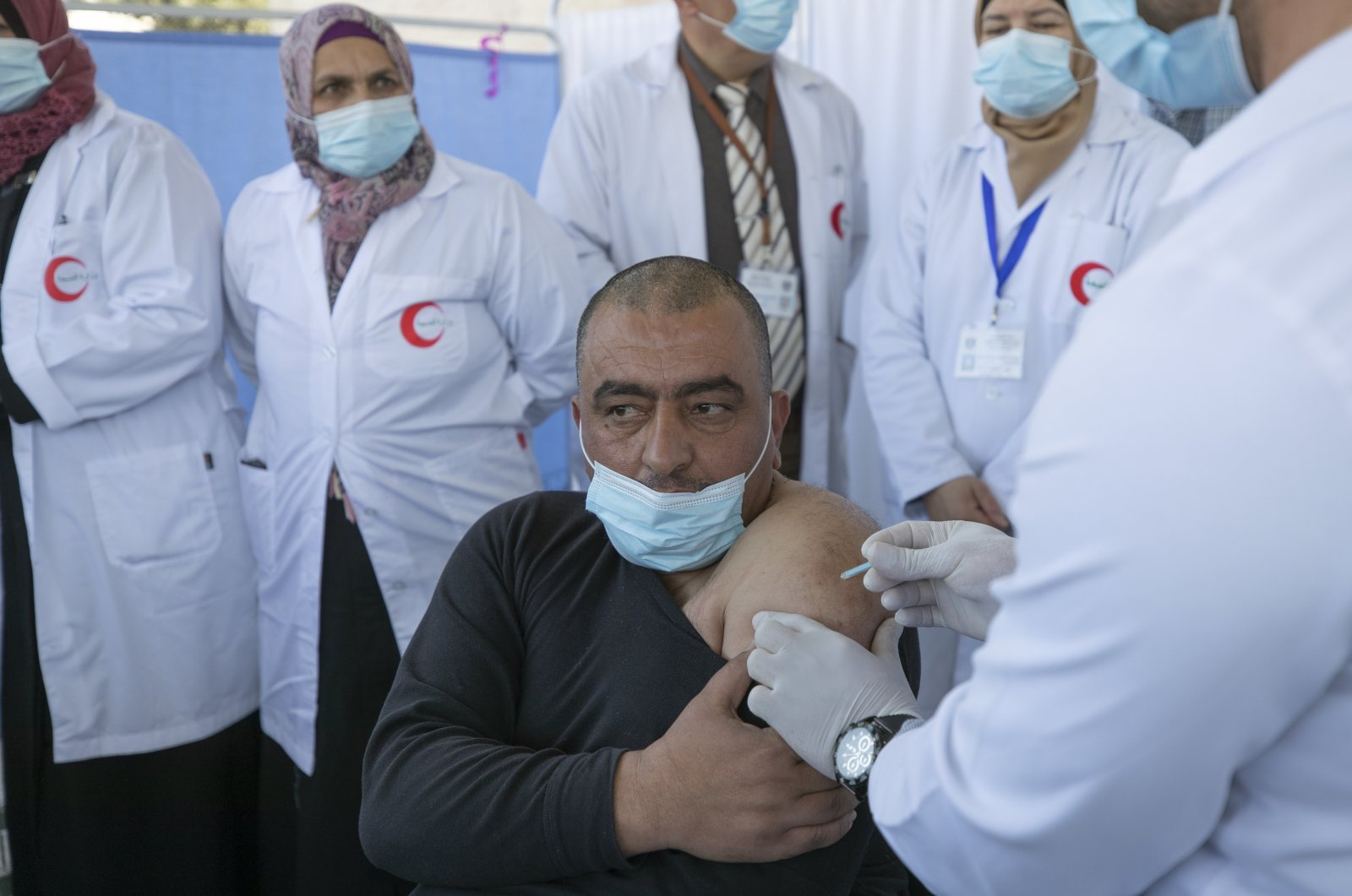 A medic administers a COVID-19 vaccine to a fellow medic during a campaign to vaccinate front-line medical workers at the health ministry in Bethlehem, occupied West Bank, Palestine, Feb. 3, 2021. (AP Photo)